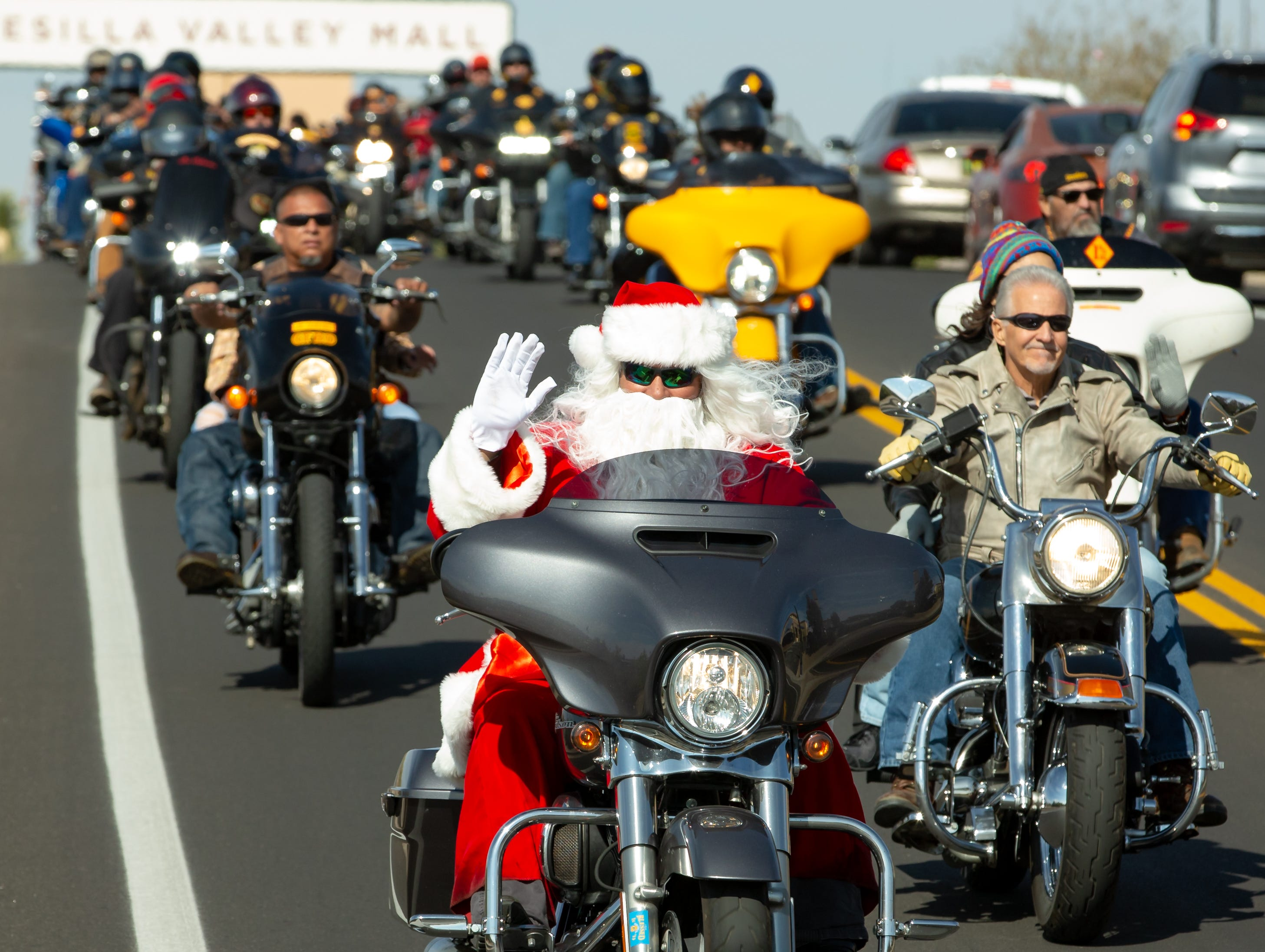 Santa joins hundreds of bikers as they cruise down  S. Don Roser Dr. on Sunday Nov. 18, 2018, during the 38th annual Toys for Kids Motorcycle Parade to benefit children in southern New Mexico.