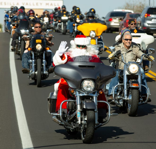Santa joins hundreds of bikers as they cruise down Don Roser Drive on Sunday Nov. 18, 2018, during the 38th annual Toys for Kids Motorcycle Parade to benefit children in southern New Mexico.