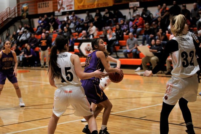Kirtland Central's Tiajhae Nez pivots to the right before hitting a jumper against Aztec during a Feb. 3 game at Lillywhite Gym in Aztec. Visit daily-times.com this week for the latest basketball content.
