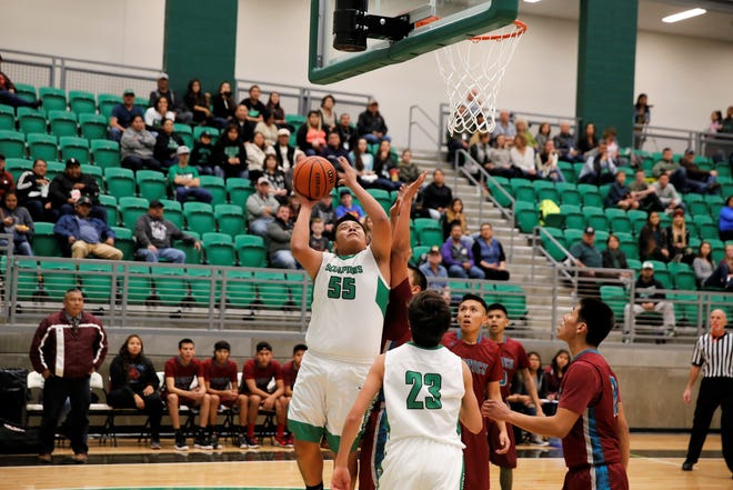 Farmington's Kobe Shorty jumps up for two points against Shiprock on Thursday, Jan. 4, 2018 at Scorpion Arena. FHS will open the new season at home Nov. 30 against Valencia.