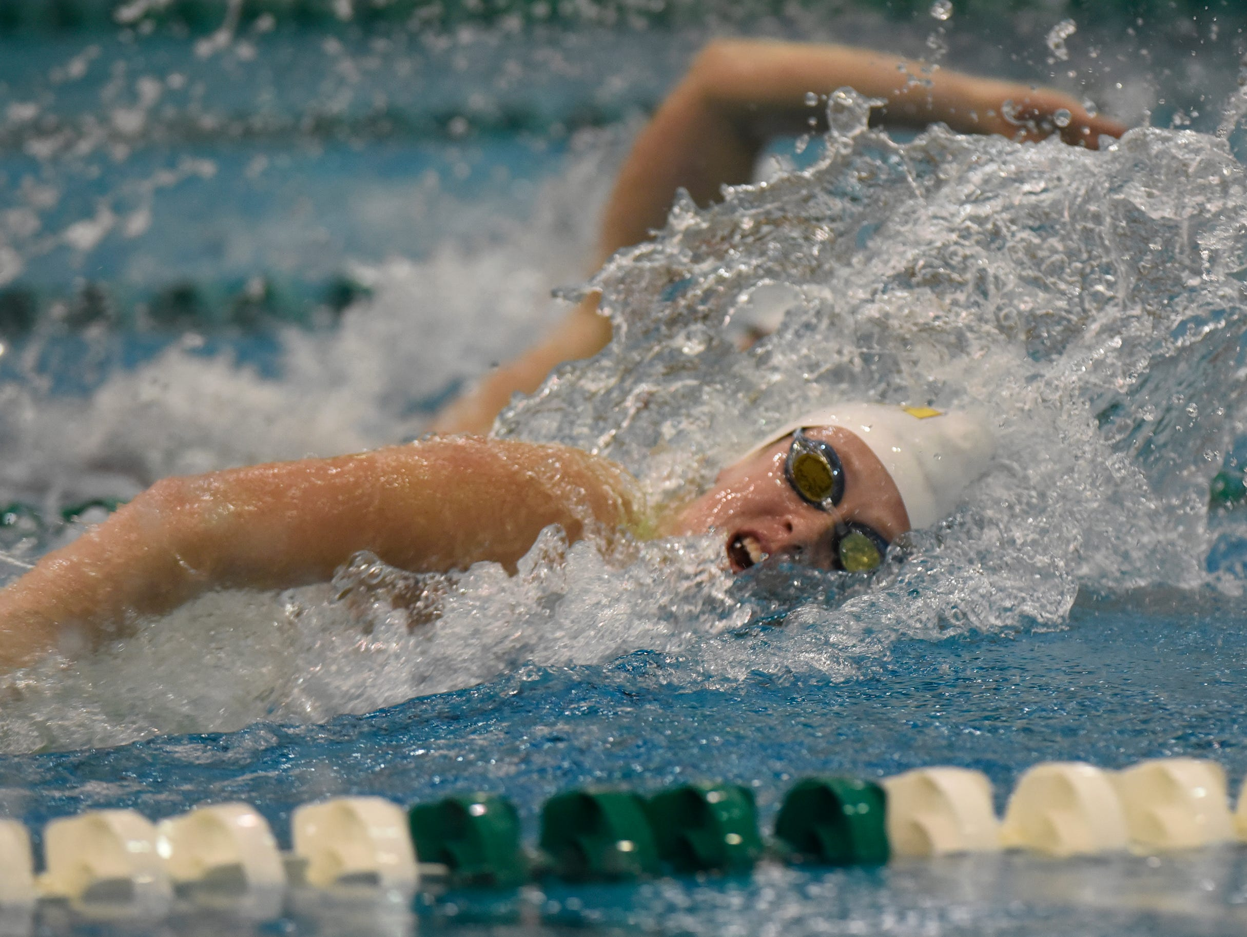 Mercy's Greta Gidley anchors the 400 yard freestyle relay at the Division 1 girls swimming and diving championships held at Eastern Michigan University Nov. 17, 2018.