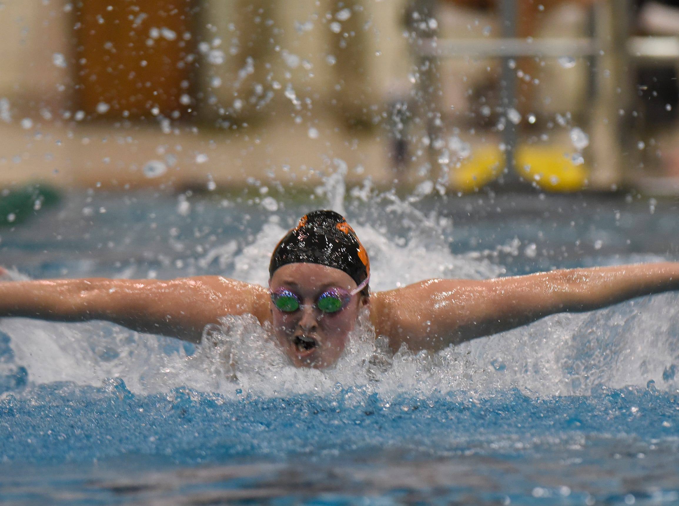 Brighton's Maddie Mince in the 100 yard butterfly at the Division 1 girls swimming and diving championships held at Eastern Michigan University Nov. 17, 2018.
