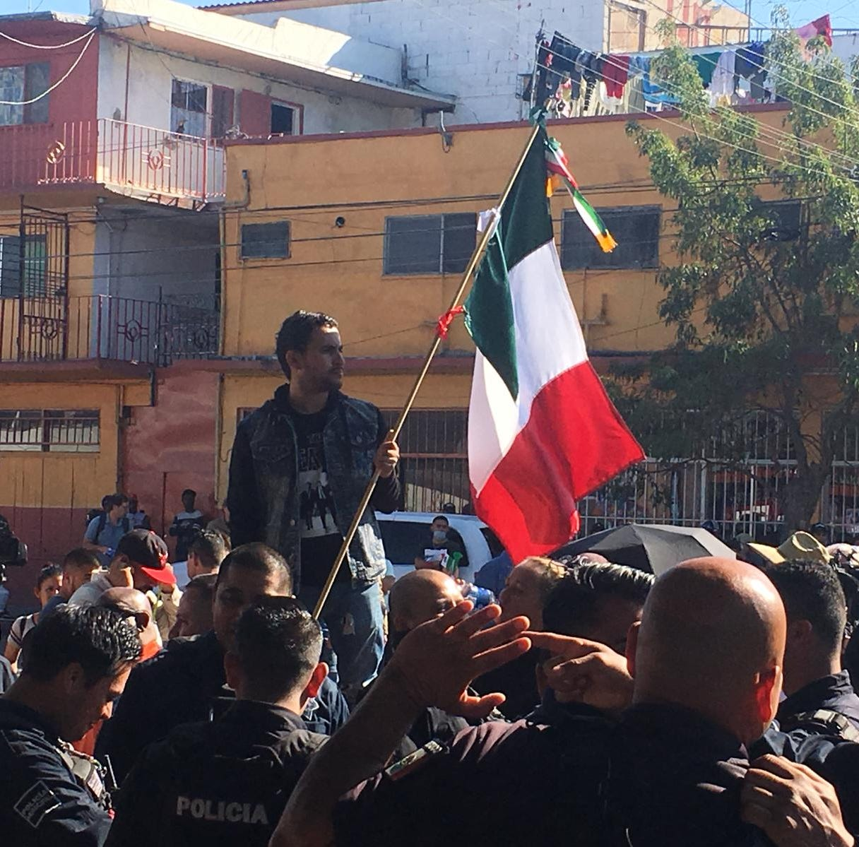 Protesters march against migrant caravan in Tijuana; Police don riot gear