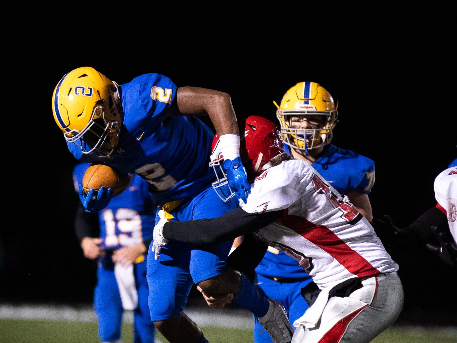 Middletown's Richie Sykes (2) leaps away from Bermudian Springs' Chase Dull (10) during the second half of the District 3 Class 3A championship game between Bermudian Springs and Middletown, Saturday, Nov. 17, 2018, at Cedar Crest High School. The Middletown Raiders defeated the Bermudian Springs Eagles 41-20 to win the title.