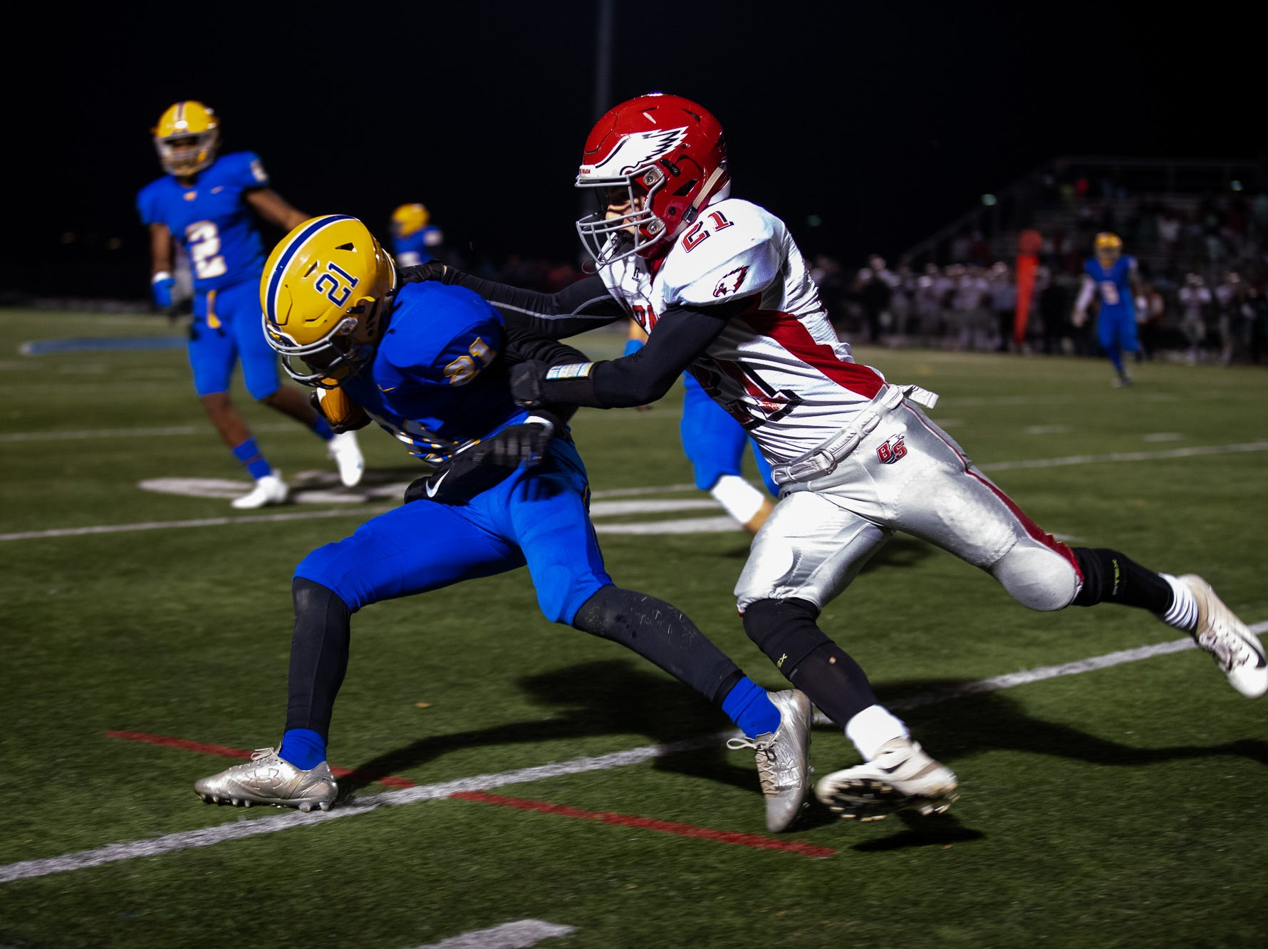 Bermudian Springs' Ryan Hart (21) brings down Middletown's Antonio Bryant (21) during the second half of the District 3 Class 3A championship game between Bermudian Springs and Middletown, Saturday, Nov. 17, 2018, at Cedar Crest High School. The Middletown Raiders defeated the Bermudian Springs Eagles 41-20 to win the title.