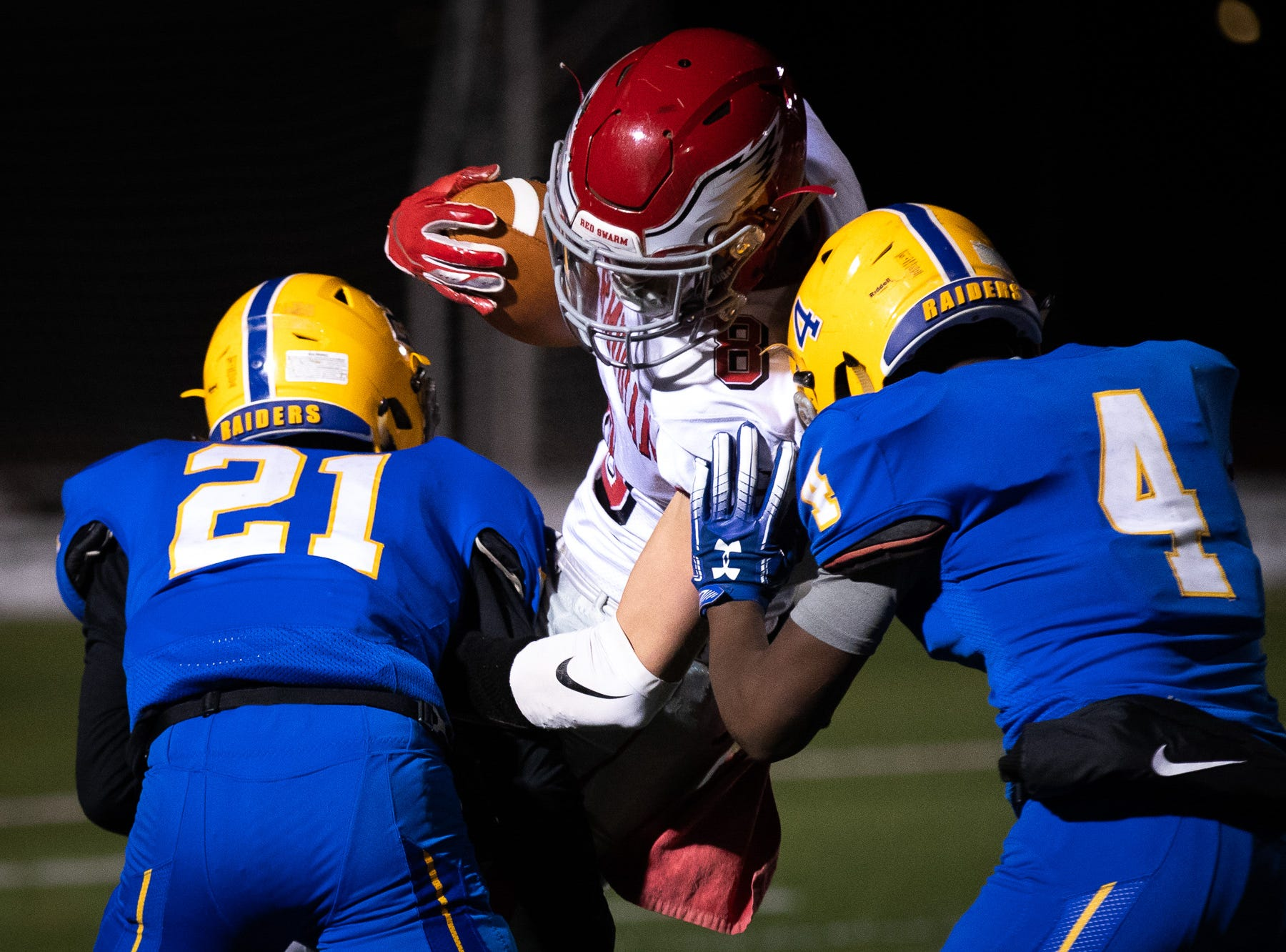 Bermudian Springs' Chase McMillan (8) is brought down by the Middletown defense during the second half of the District 3 Class 3A championship game between Bermudian Springs and Middletown, Saturday, Nov. 17, 2018, at Cedar Crest High School. The Middletown Raiders defeated the Bermudian Springs Eagles 41-20 to win the title.