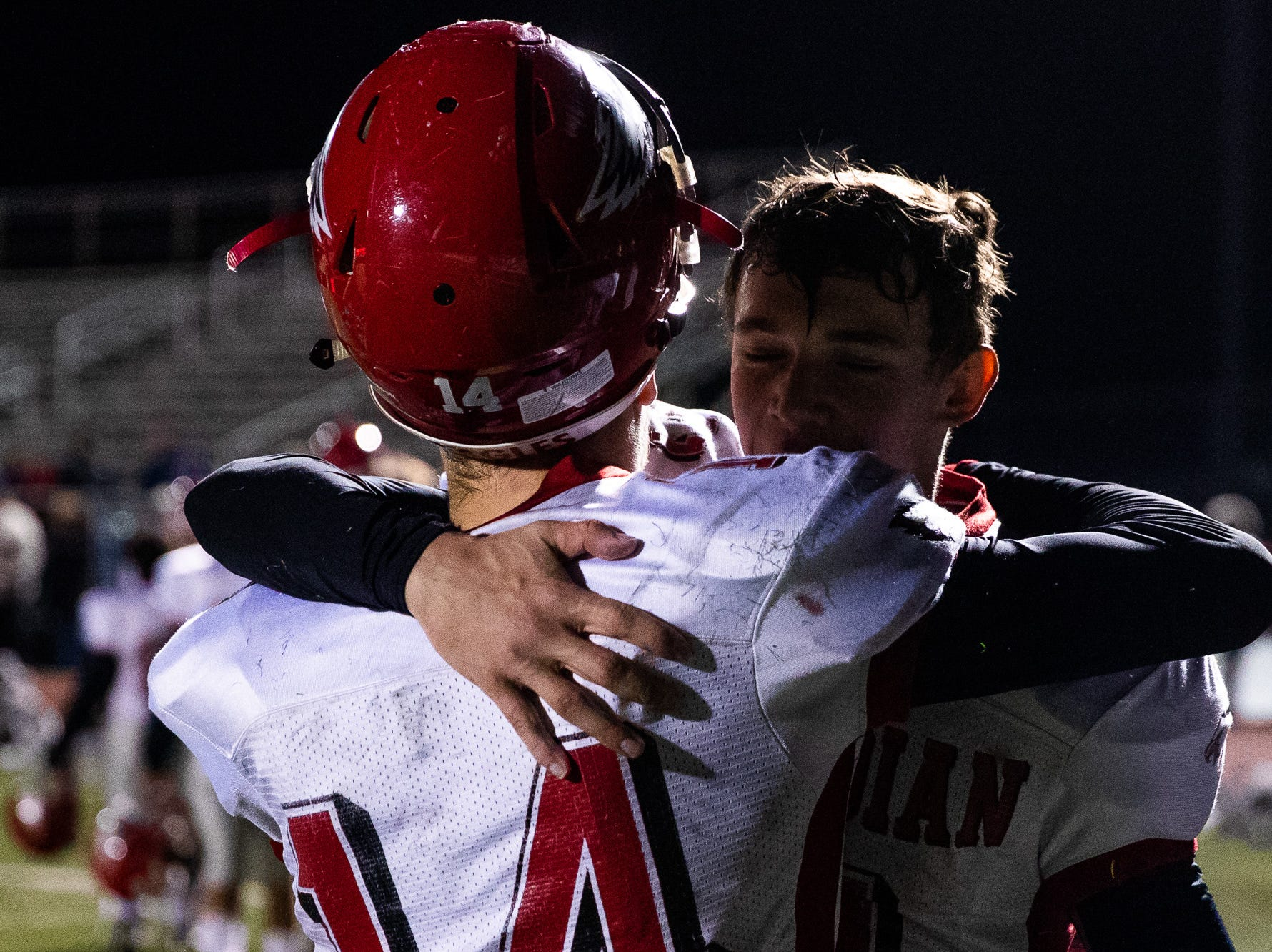 Members of the Bermudian Springs Eagles embrace as they walk off the field after losing the District 3 Class 3A championship game against Middletown, Saturday, Nov. 17, 2018, at Cedar Crest High School. The Middletown Raiders defeated the Bermudian Springs Eagles 41-20 to win the title.