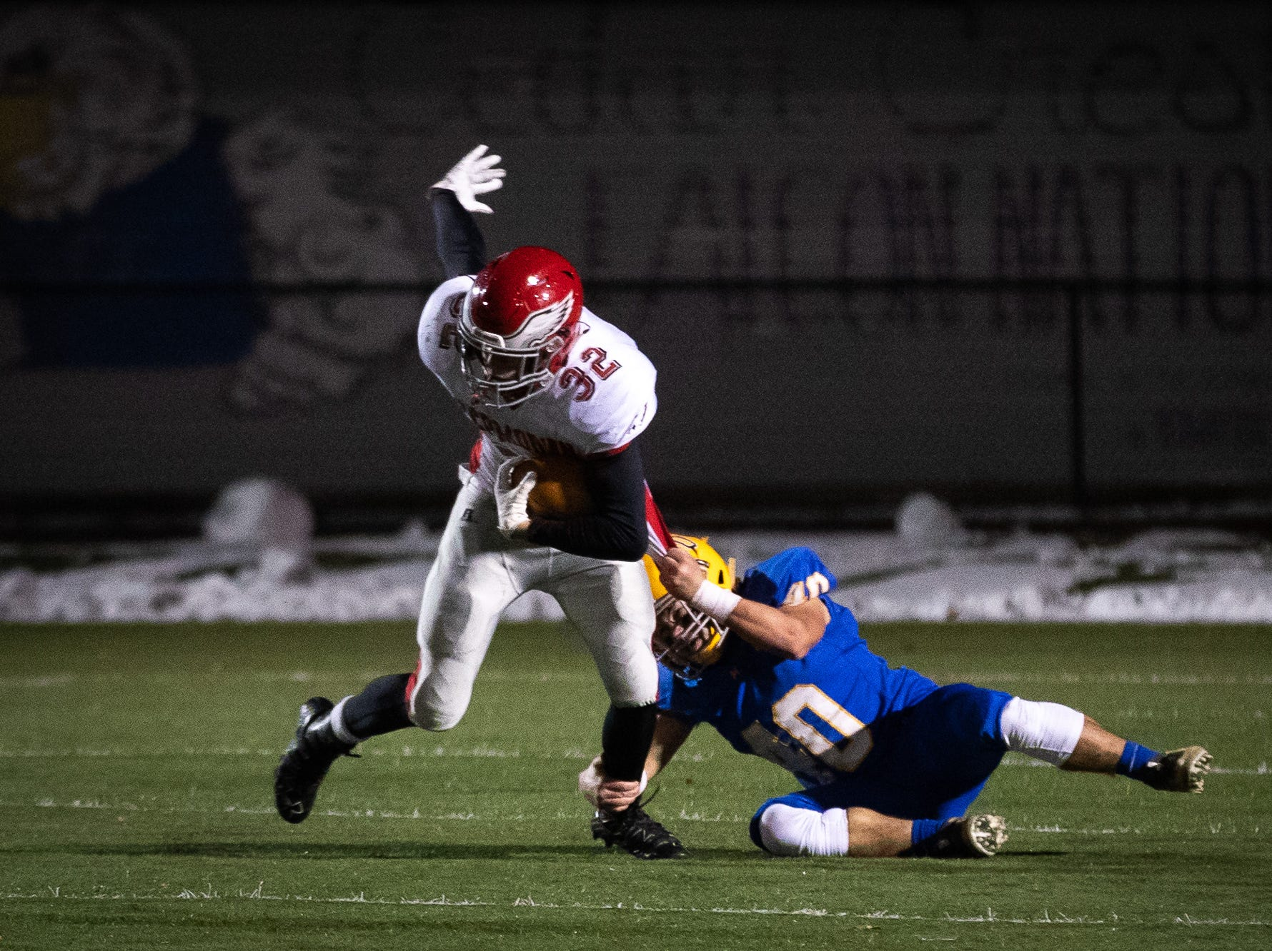 Bermudian Springs' Thomas Bross (32) is brought down by Middletown's Gage Radabaugh (40) during the second half of the District 3 Class 3A championship game between Bermudian Springs and Middletown, Saturday, Nov. 17, 2018, at Cedar Crest High School. The Middletown Raiders defeated the Bermudian Springs Eagles 41-20 to win the title.