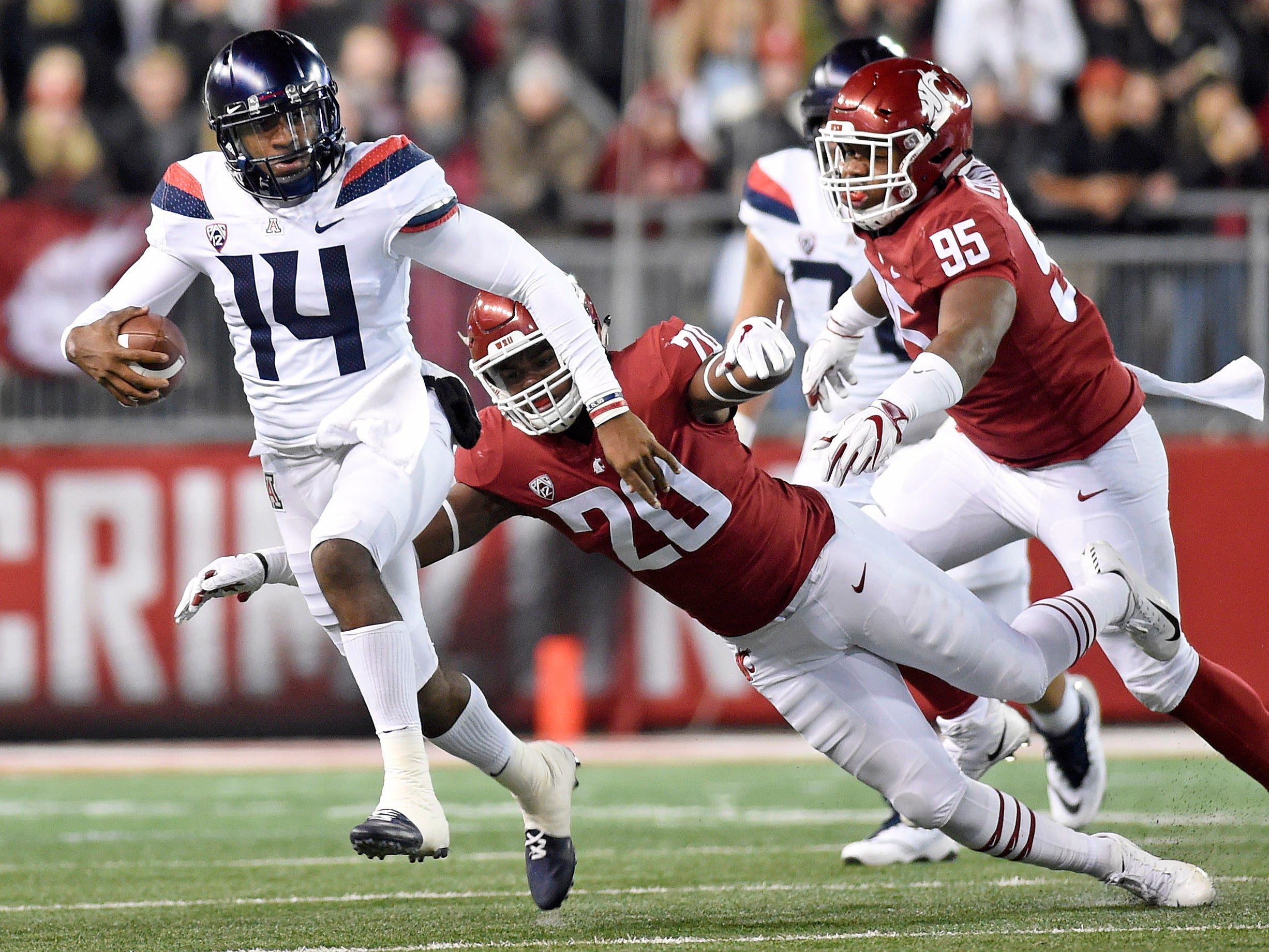 Nov 17, 2018; Pullman, WA, USA; Arizona Wildcats quarterback Khalil Tate (14) gets away from Washington State Cougars linebacker Dominick Silvels (20) in the first half at Martin Stadium. Mandatory Credit: James Snook-USA TODAY Sports