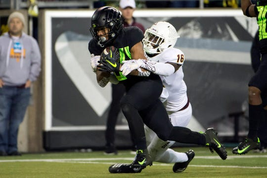 Oregon Ducks running back CJ Verdell (34) carries Arizona State Sun Devils safety Aashari Crosswell (16) into the end zone for a touchdown during the first half at Autzen Stadium. Troy Wayrynen-USA TODAY Sports