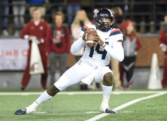 Nov 17, 2018; Pullman, WA, USA; Arizona Wildcats quarterback Khalil Tate (14) slips while dropping back for a pass against the Washington State Cougars in the first half at Martin Stadium. Mandatory Credit: James Snook-USA TODAY Sports