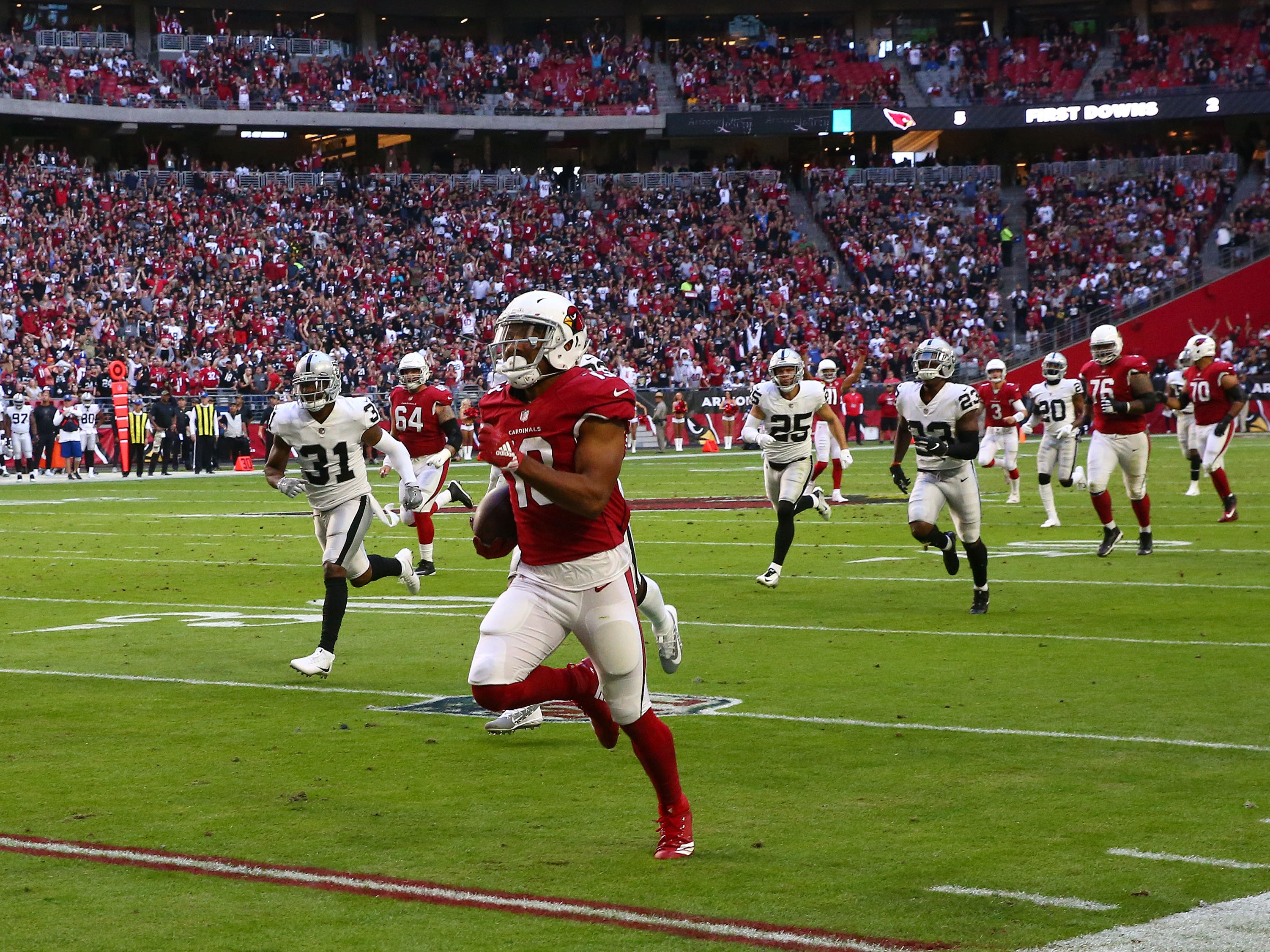 Arizona Cardinals wide receiver Christian Kirk makes a touchdown catch against the Oakland Raiders in the first half during a game Nov. 18 at State Farm Stadium.