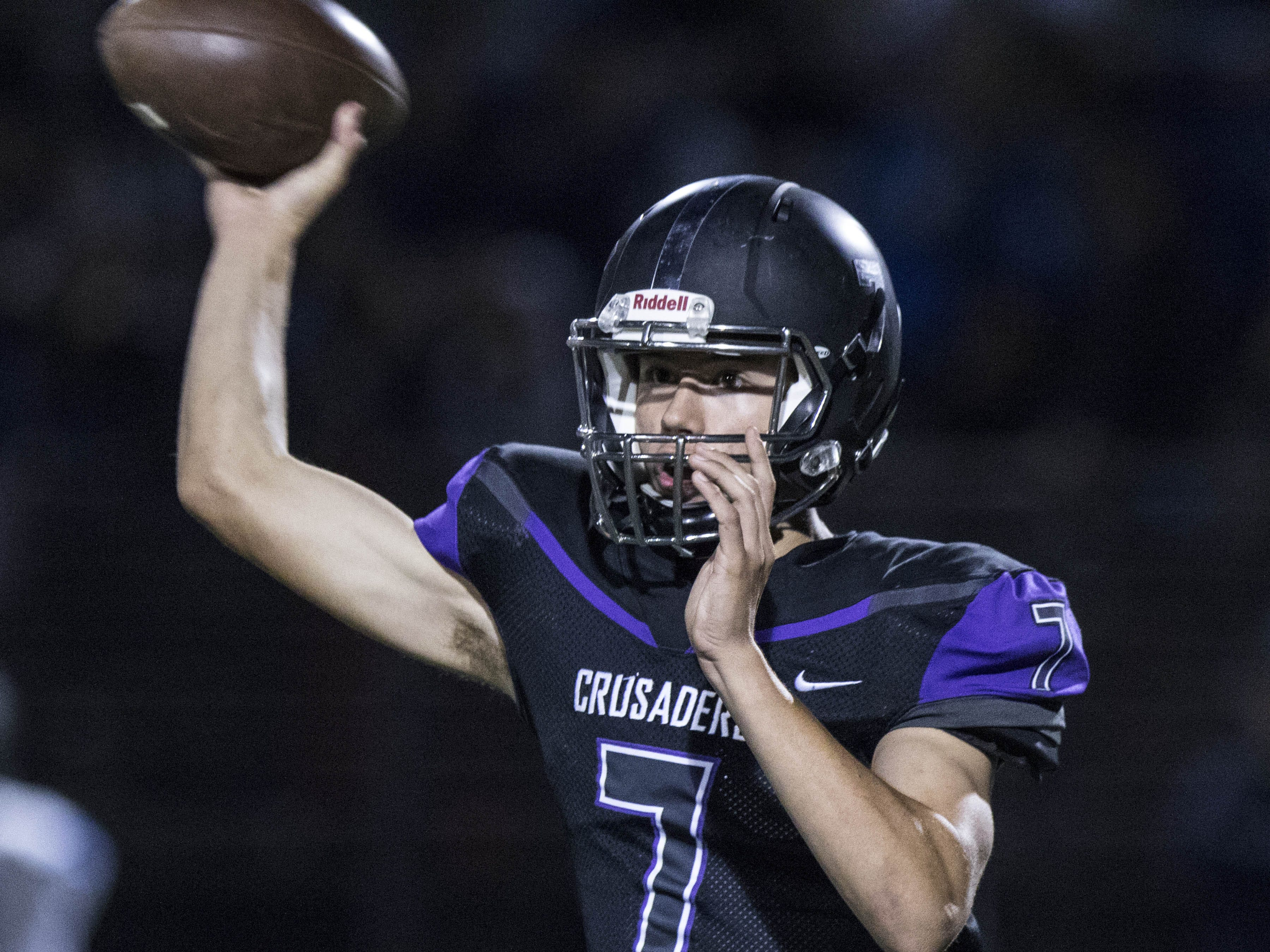 Northwest Christian's Jonathan Metzger throws against Valley Christian's defense during their game at North Canyon High School in Phoenix  Friday, Nov.17, 2018. #azhsfb
