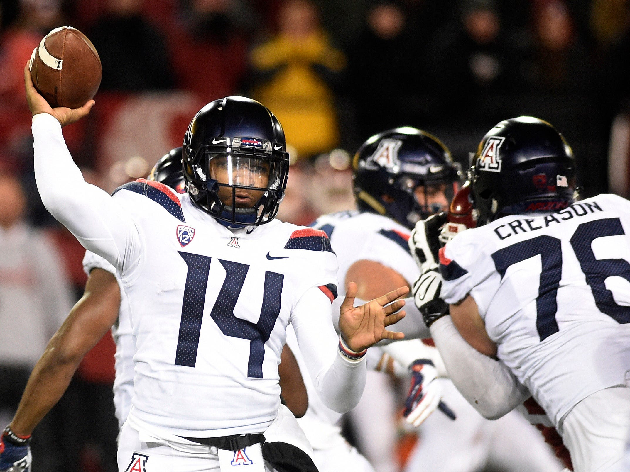 Nov 17, 2018; Pullman, WA, USA; Arizona Wildcats quarterback Khalil Tate (14) throws the football during a game against the Washington State Cougars in the second half at Martin Stadium. Mandatory Credit: James Snook-USA TODAY Sports