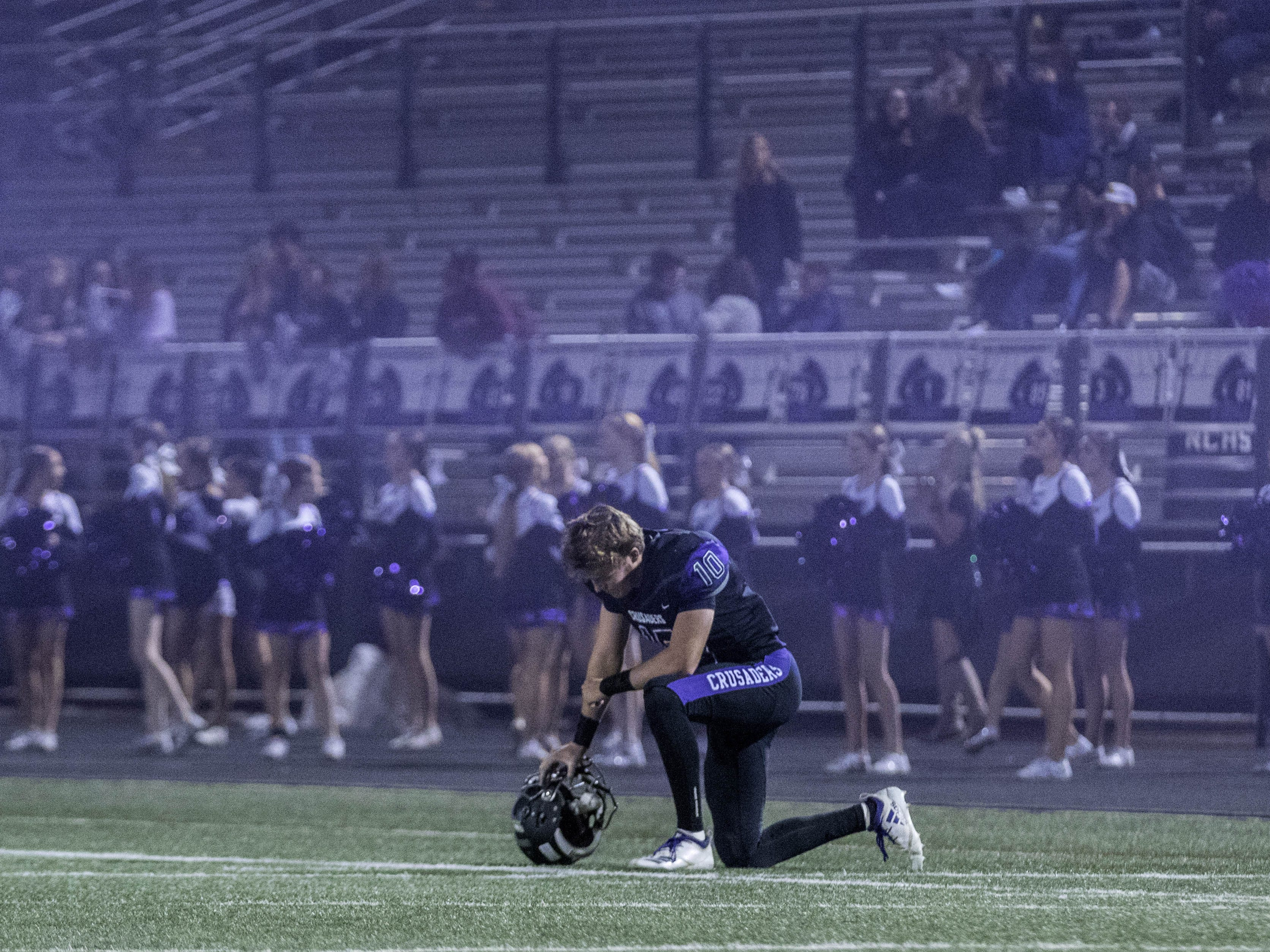 Northwest Christian's Aren Van Hofwegen has a moment to himself before their game with Valley Christian at North Canyon High School in Phoenix  Friday, Nov.17, 2018. #azhsfb