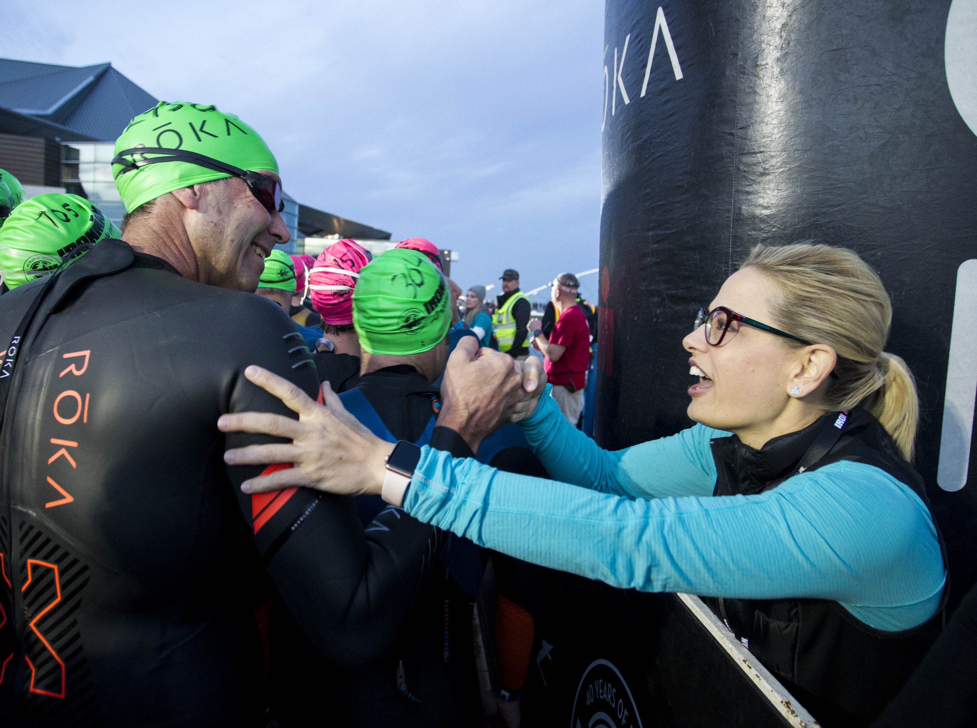 U.S. Sen.-elect Kyrsten Sinema encourage athletes before they start their swim during the Tempe Ironman at Tempe Town Lake Nov.18, 2018.