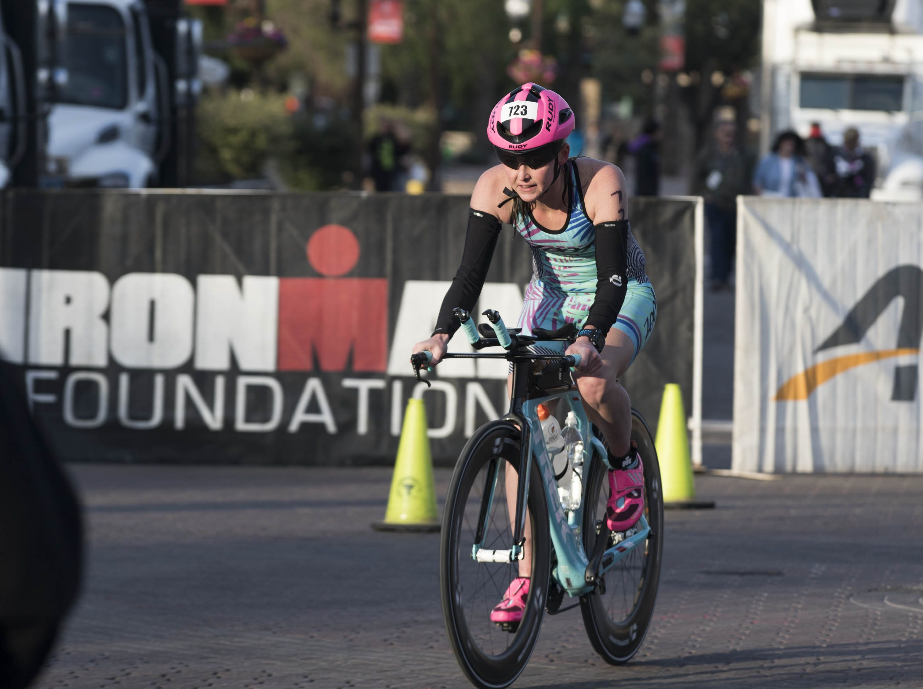 An Ironman competitor starts the bike portion of the race during the Tempe Ironman at Tempe Town Lake Nov.18, 2018.
