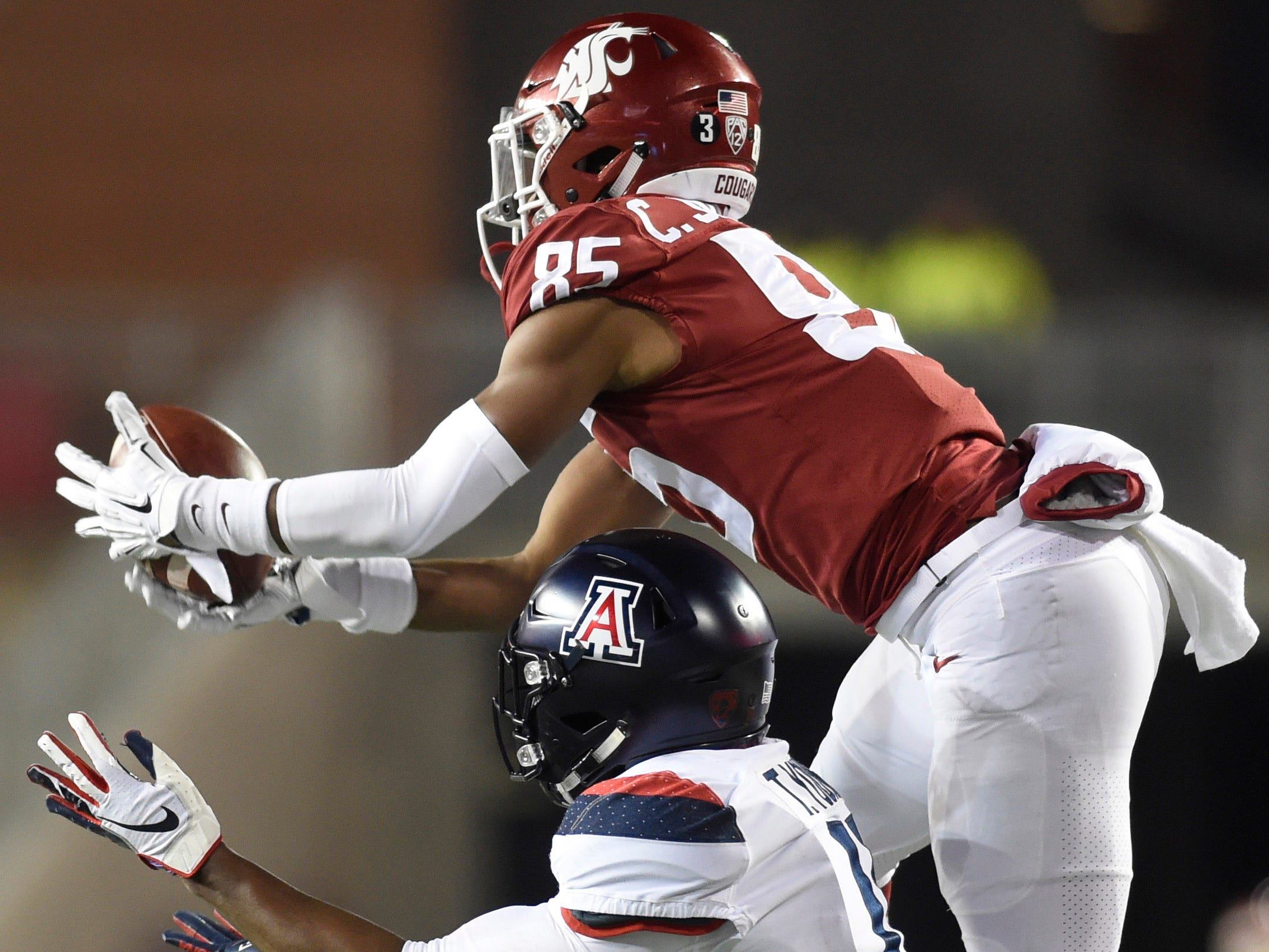 Nov 17, 2018; Pullman, WA, USA; Washington State Cougars wide receiver Calvin Jackson Jr. (85) goes up over Arizona Wildcats safety Troy Young (11) to catch the football for a first down in the second half at Martin Stadium. Mandatory Credit: James Snook-USA TODAY Sports