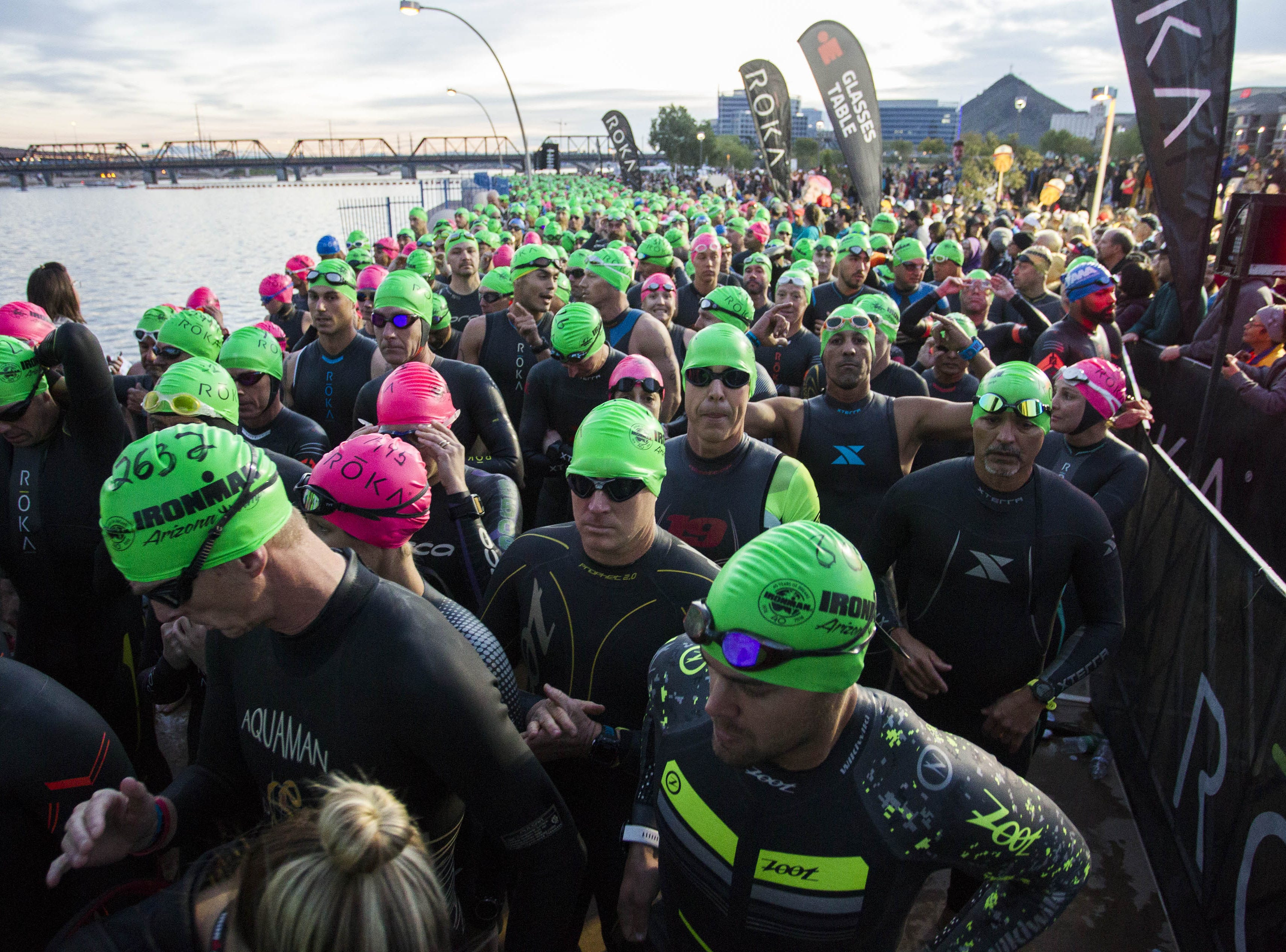 Athletes wait to start their swim during the Tempe Ironman competition at Tempe Town Lake Nov.18, 2018.