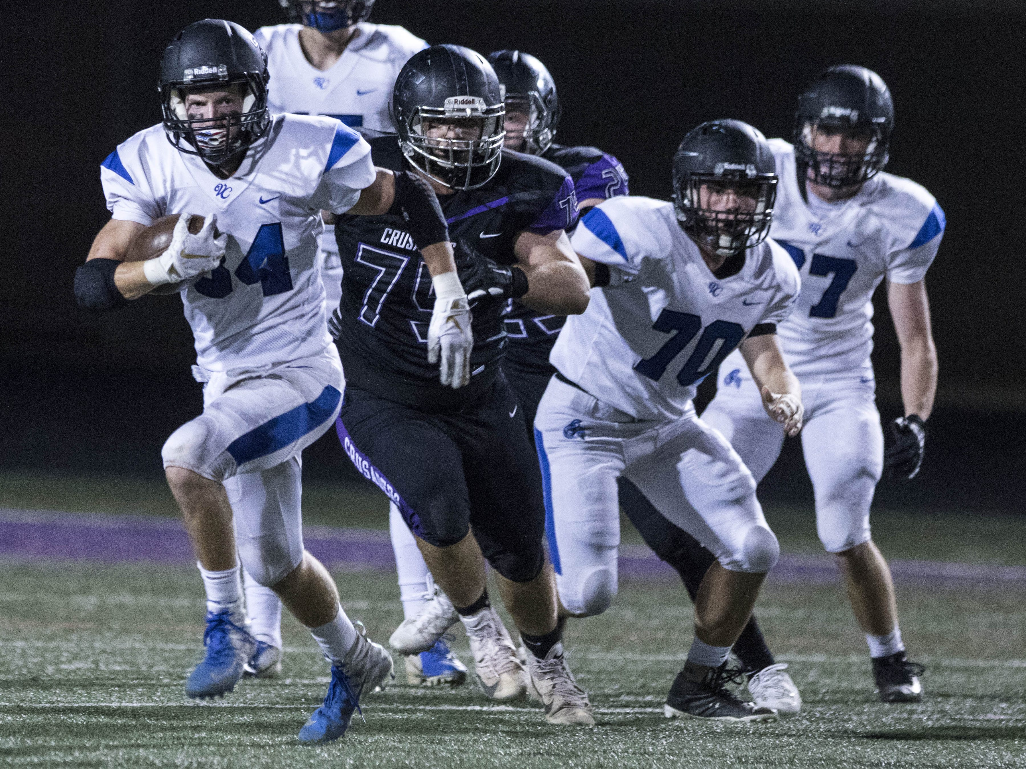 Valley Christian's Nathan Dykstra (34) finds running room against Northwest Christian during their game at North Canyon High School in Phoenix  Friday, Nov.17, 2018. #azhsfb