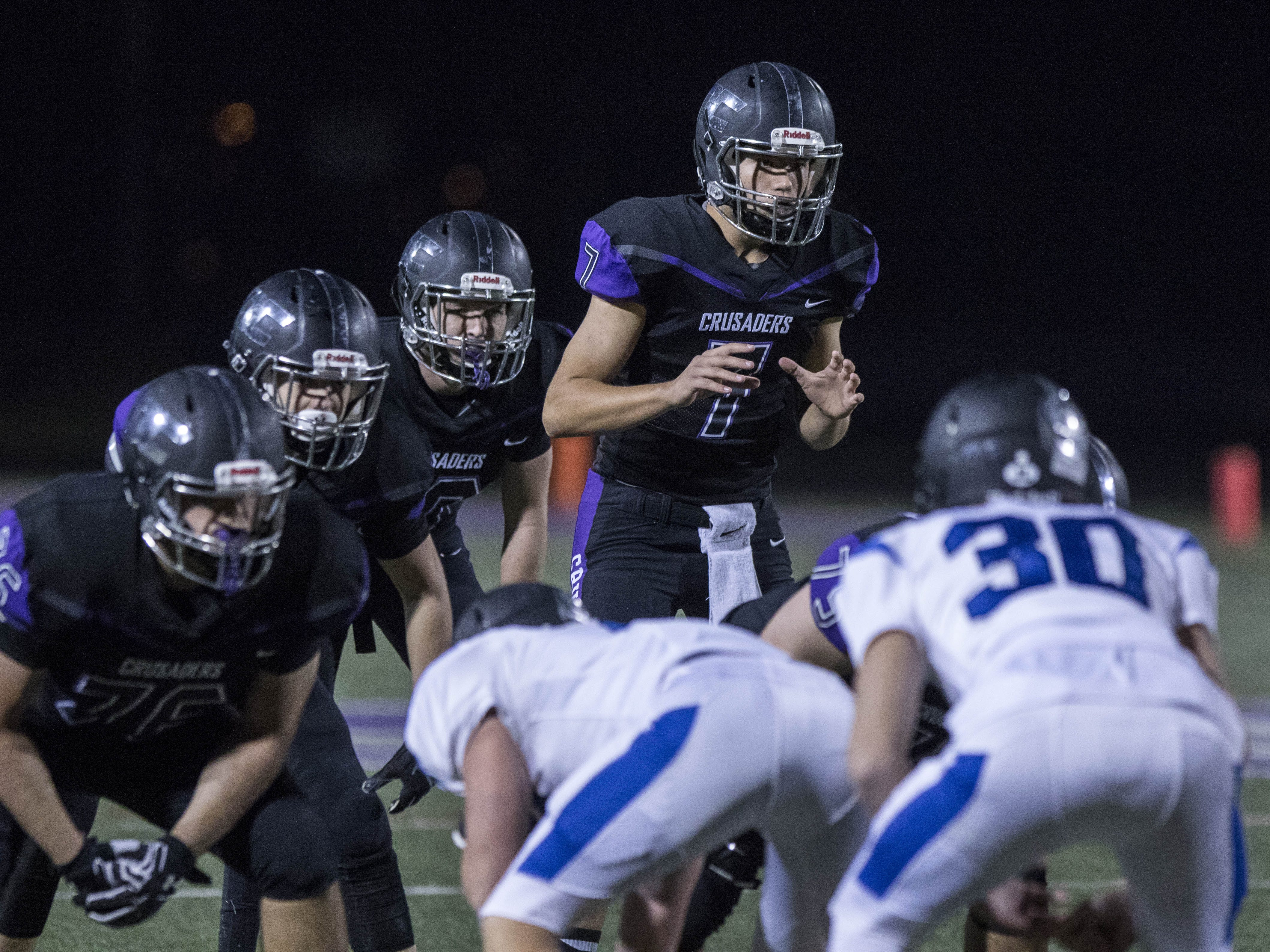 Northwest Christian quarterback Jonathan Metzger (7) calls a play during their game with Valley Christian at North Canyon High School in Phoenix  Friday, Nov.17, 2018. #azhsfb