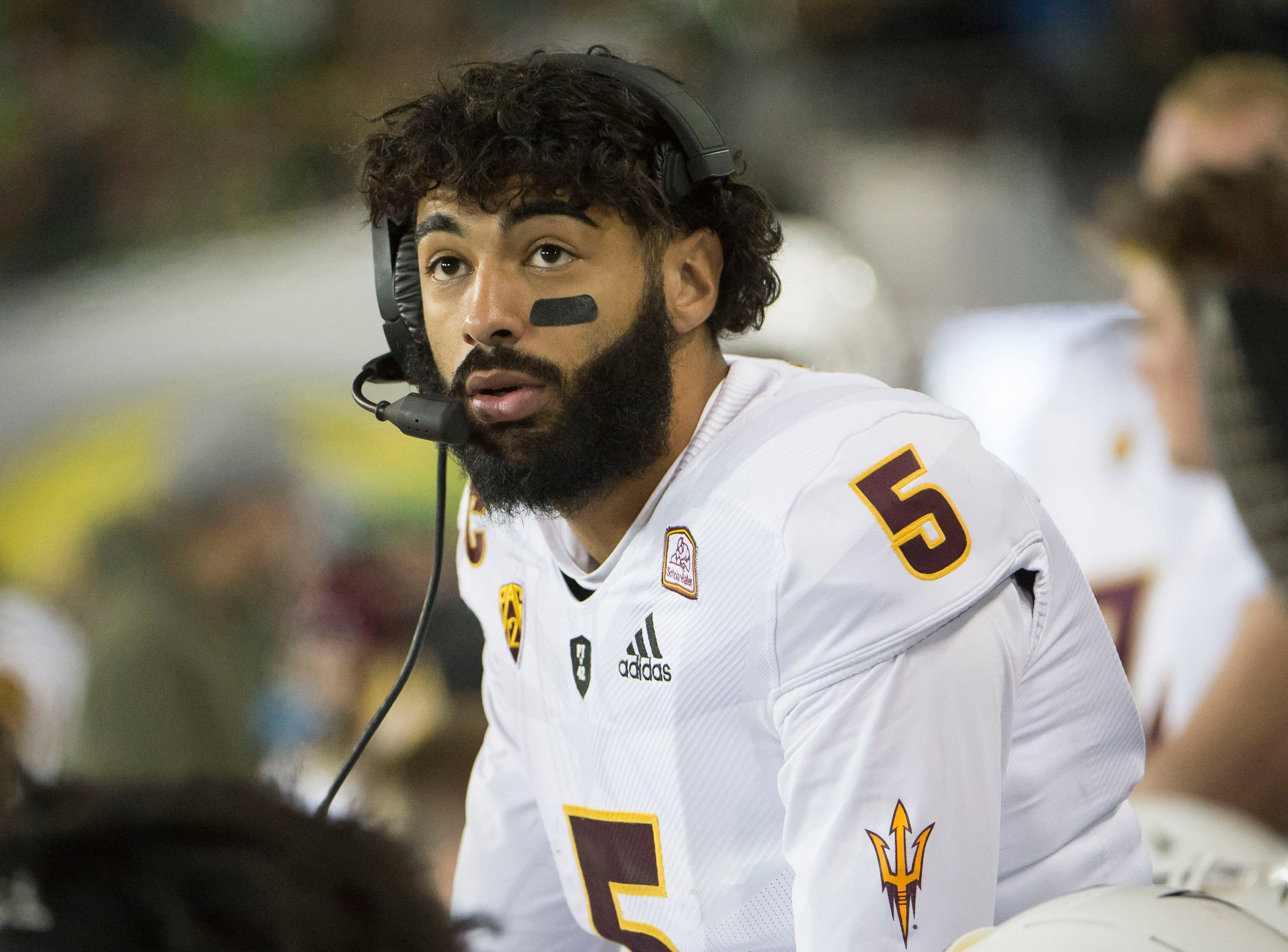 Nov 17, 2018; Eugene, OR, USA; Arizona State Sun Devils quarterback Manny Wilkins (5) talks to coaches on the sidelines during the first half against the Oregon Ducks at Autzen Stadium. Mandatory Credit: Troy Wayrynen-USA TODAY Sports