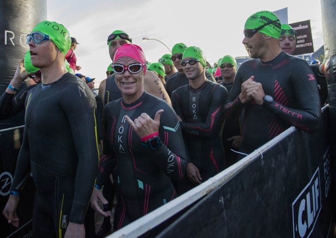 Athletes prepare to start their swim during the Tempe Ironman competition at Tempe Town Lake Nov.18, 2018.