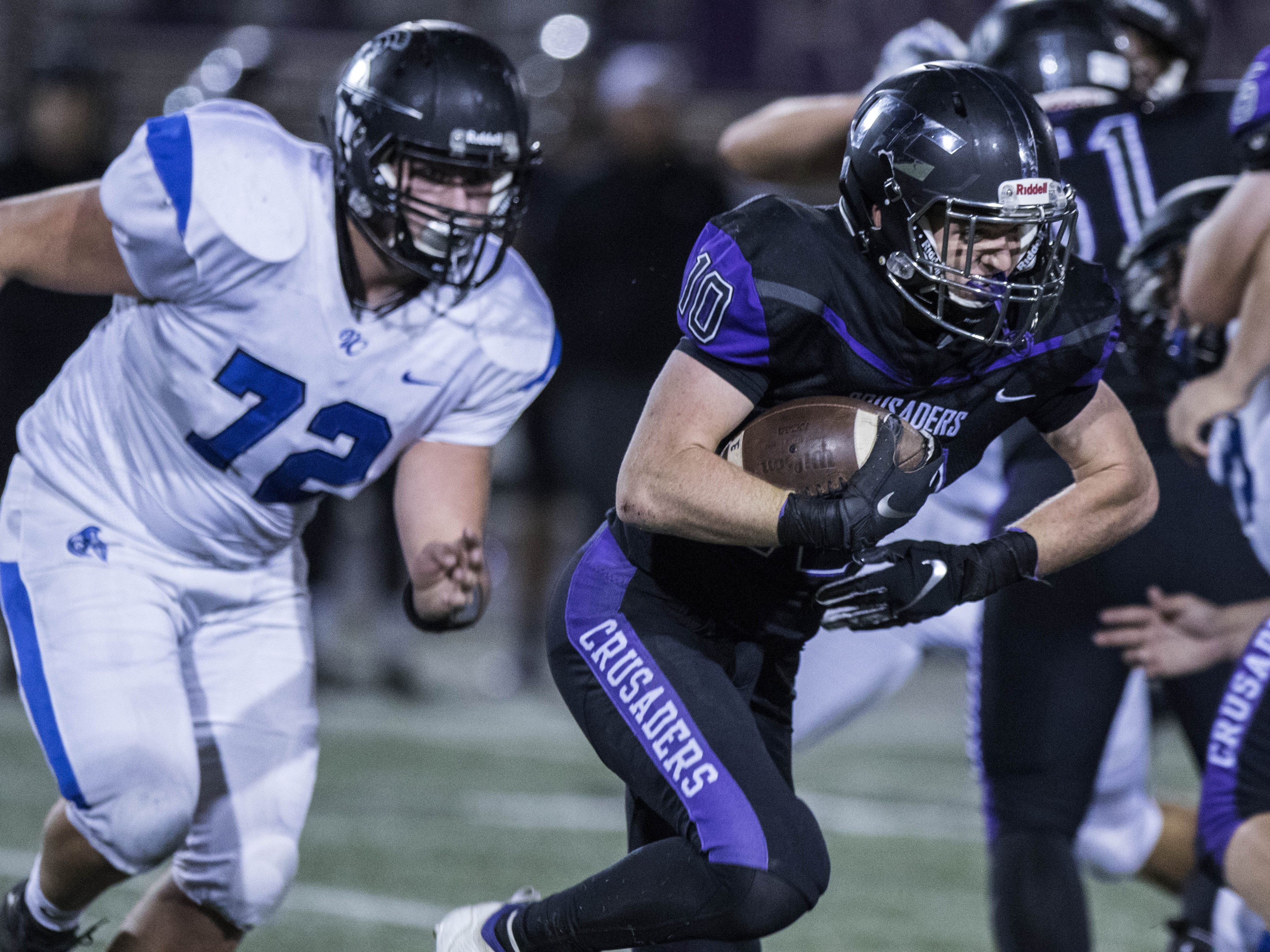 Northwest Christian's Aren Van Hofwegen (10) finds running room against Valley Christian's defense during their game at North Canyon High School in Phoenix  Friday, Nov.17, 2018. #azhsfb
