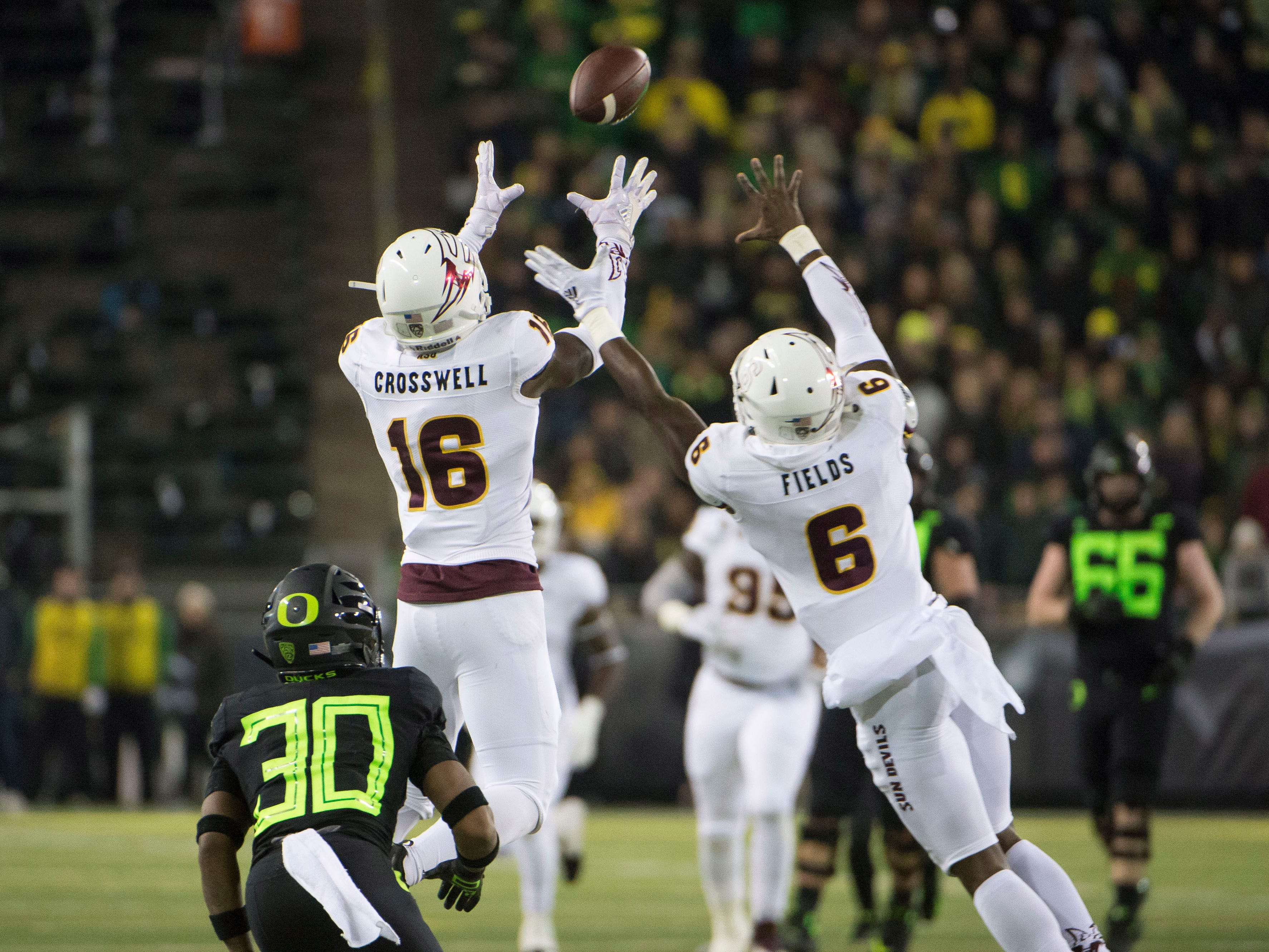 Nov 17, 2018; Eugene, OR, USA; Arizona State Sun Devils safety Aashari Crosswell (16) intercepts a pass during the first half intended for Oregon Ducks wide receiver Jaylon Redd (30) at Autzen Stadium. Mandatory Credit: Troy Wayrynen-USA TODAY Sports