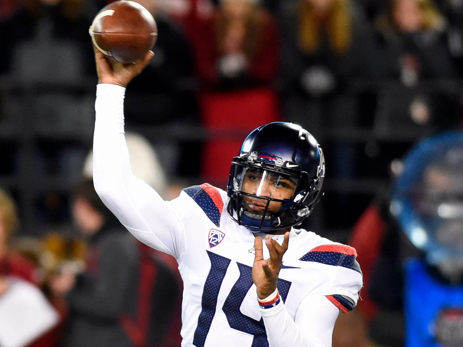 Nov 17, 2018; Pullman, WA, USA; Arizona Wildcats quarterback Khalil Tate (14) throws a football during a game against the Washington State Cougars in the first half at Martin Stadium. Mandatory Credit: James Snook-USA TODAY Sports