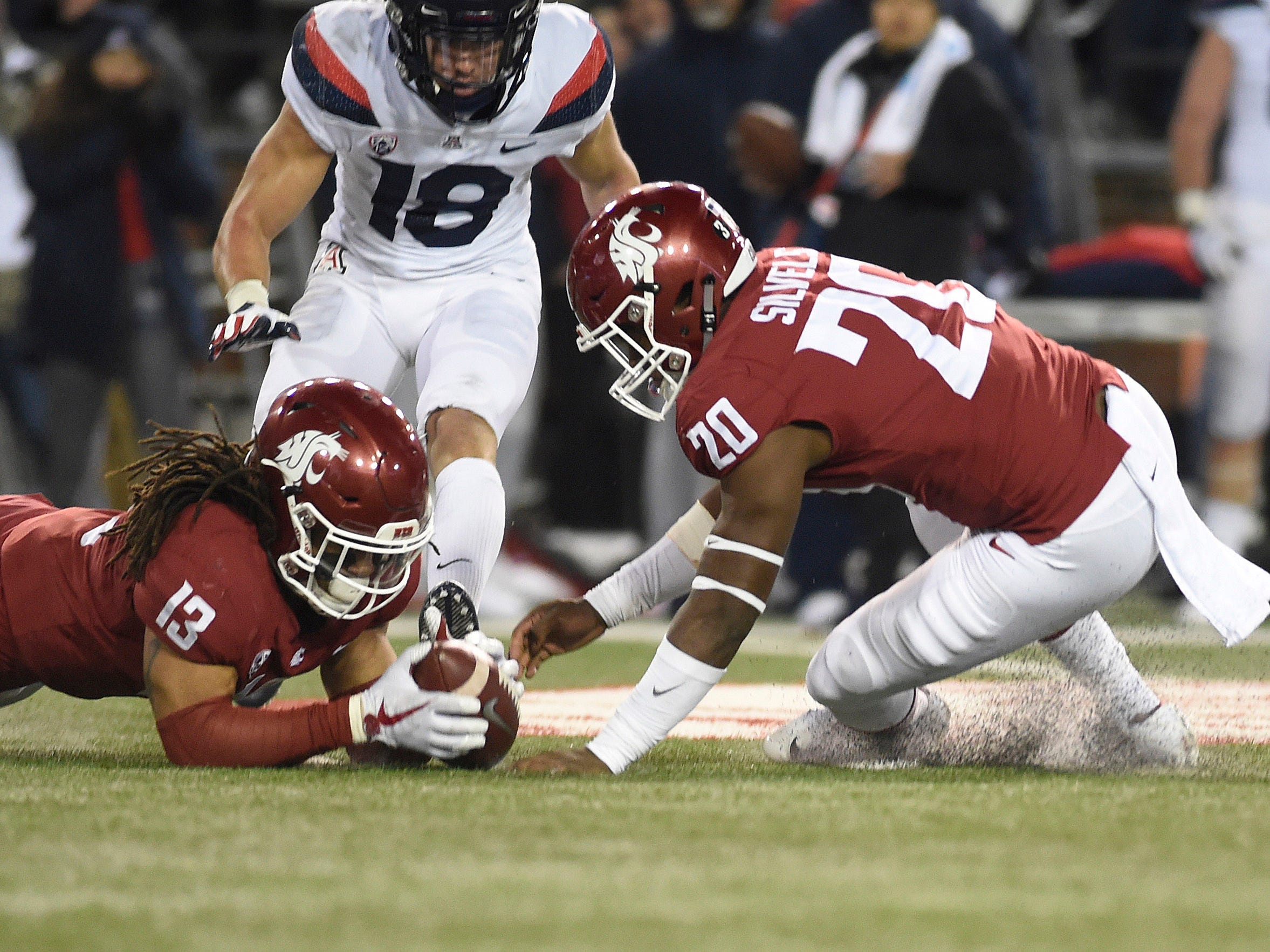 Nov 17, 2018; Pullman, WA, USA; Washington State Cougars linebacker Jahad Woods (13) recovers the fumble against Arizona Wildcats wide receiver Cedric Peterson (18) in the second half at Martin Stadium. Mandatory Credit: James Snook-USA TODAY Sports