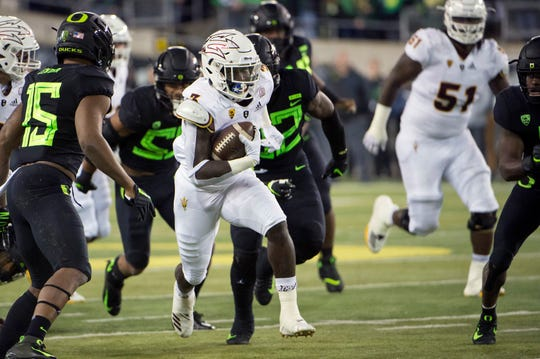 Arizona State Sun Devils running back Eno Benjamin (3) breaks away from Oregon Ducks defenders during the first half for a first down at Autzen Stadium. Troy Wayrynen-USA TODAY Sports