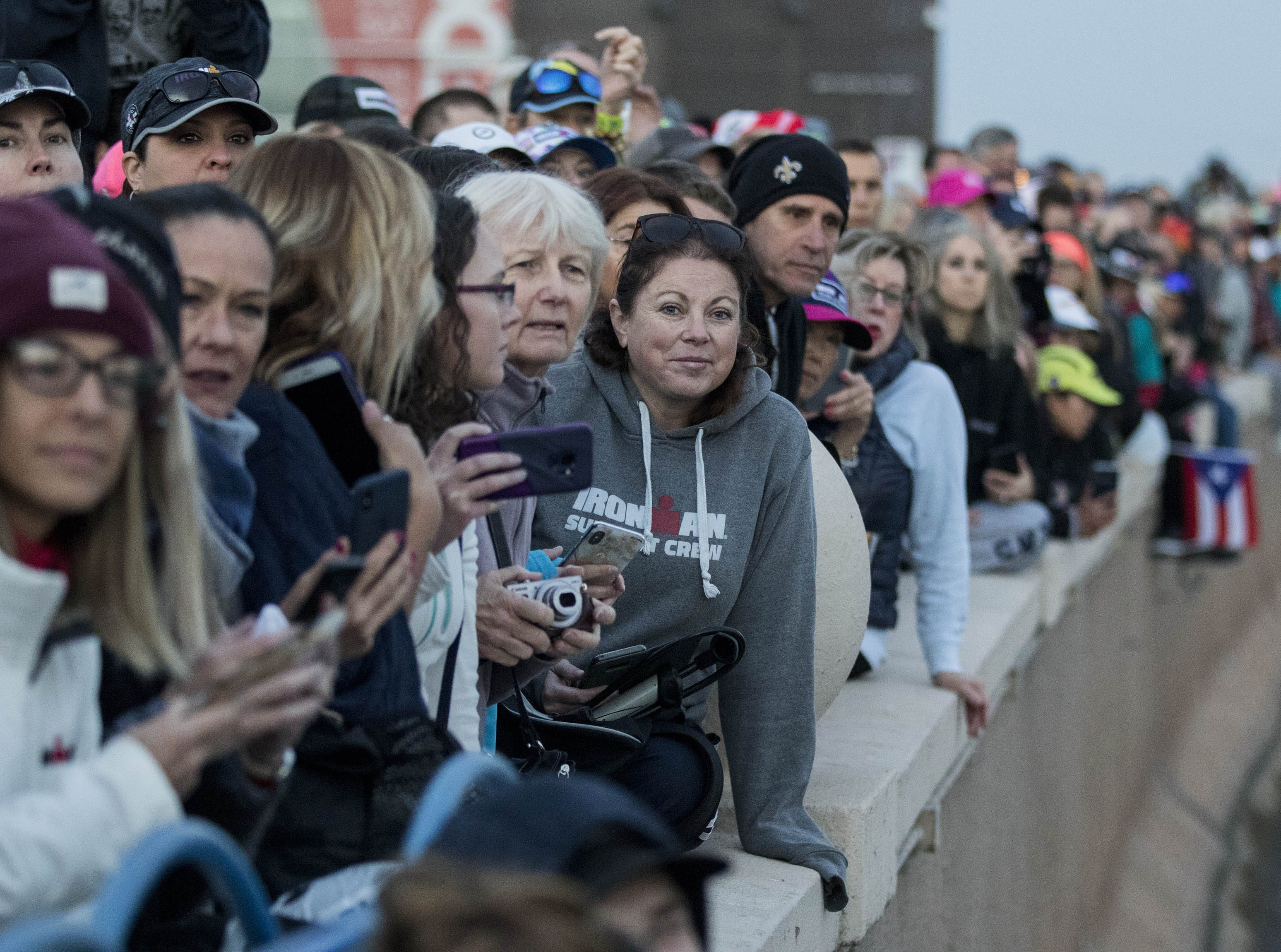 Family and friends wait as their favorite Ironman competitor to start their swim during the Tempe Ironman at Tempe Town Lake Nov.18, 2018.