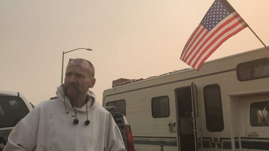 At the Chico Walmart camp on Nov. 17, Edmond McCullough is one of the dozens of Camp Fire survivors who are living in tents, trailers, campers and cars.