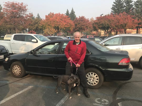 63-year-old Jim Larkin and his silver-gray pit bull, named