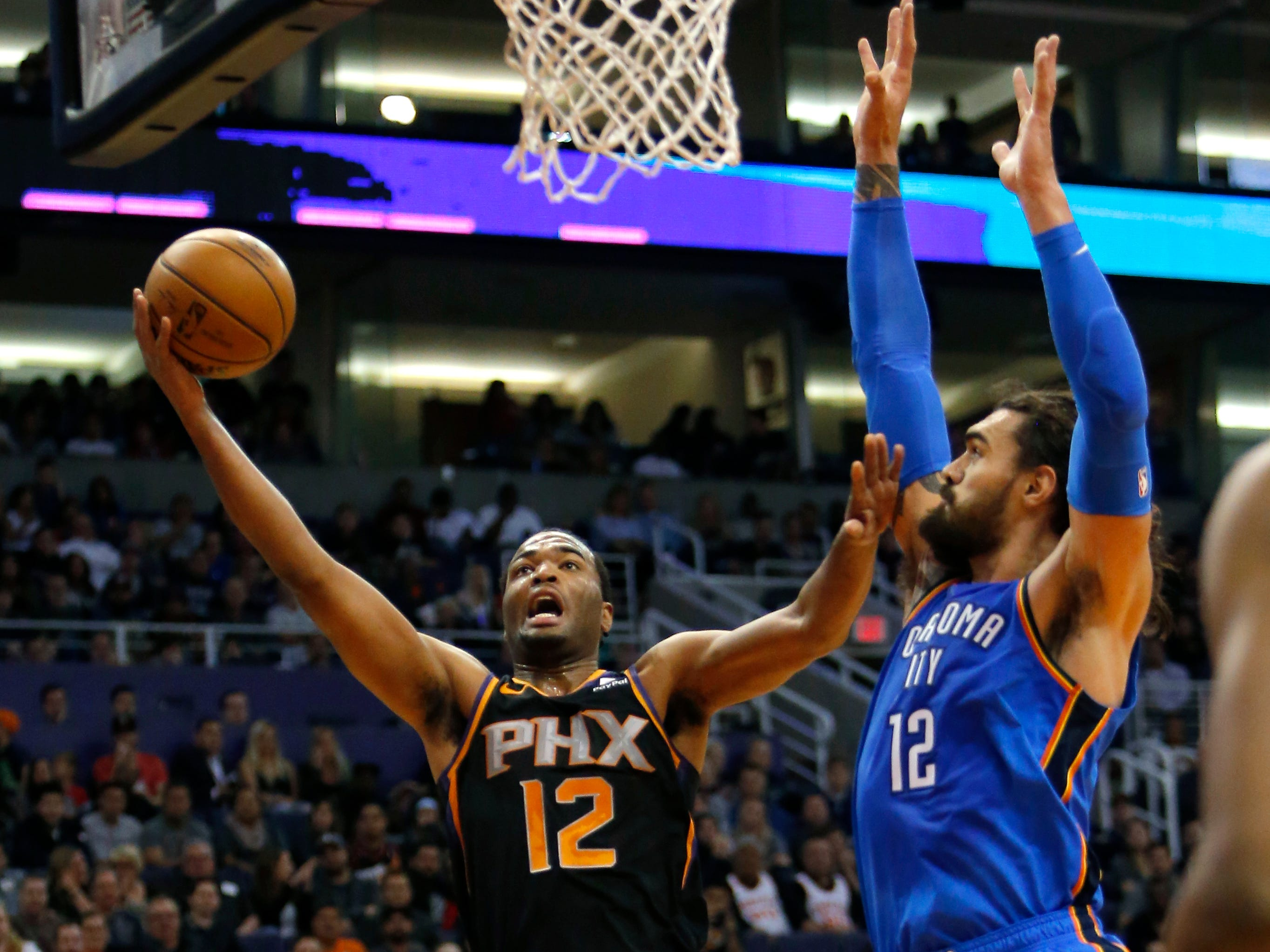 Phoenix Suns forward TJ Warren (12) in the first half during an NBA basketball game against the Oklahoma City Thunder, Saturday, Nov. 17, 2018, in Phoenix. (AP Photo/Rick Scuteri)