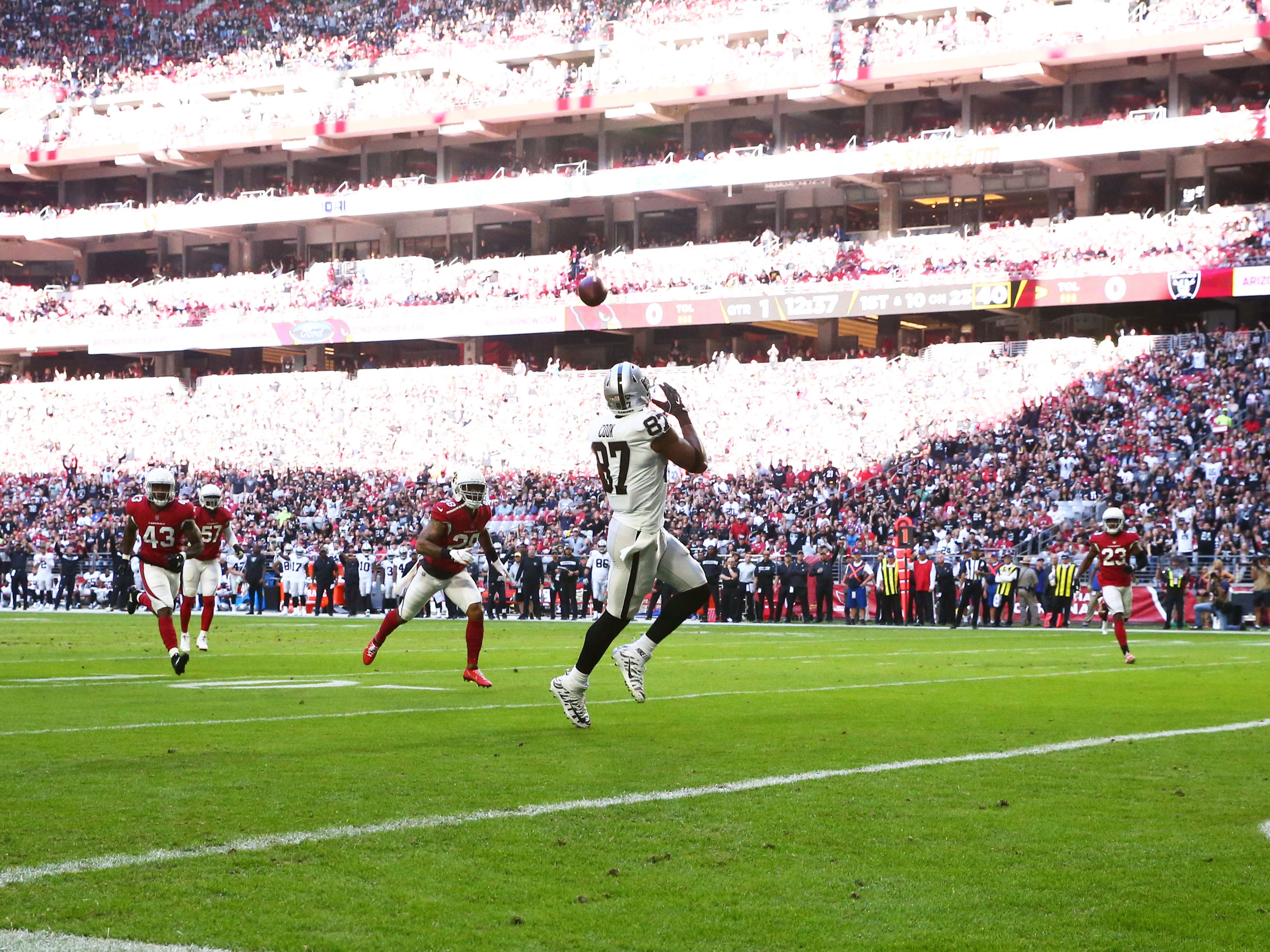 Oakland Raiders tight end Jared Cook makes a touchdown catch against the Arizona Cardinals in the first half during a game Nov. 18 at State Farm Stadium.