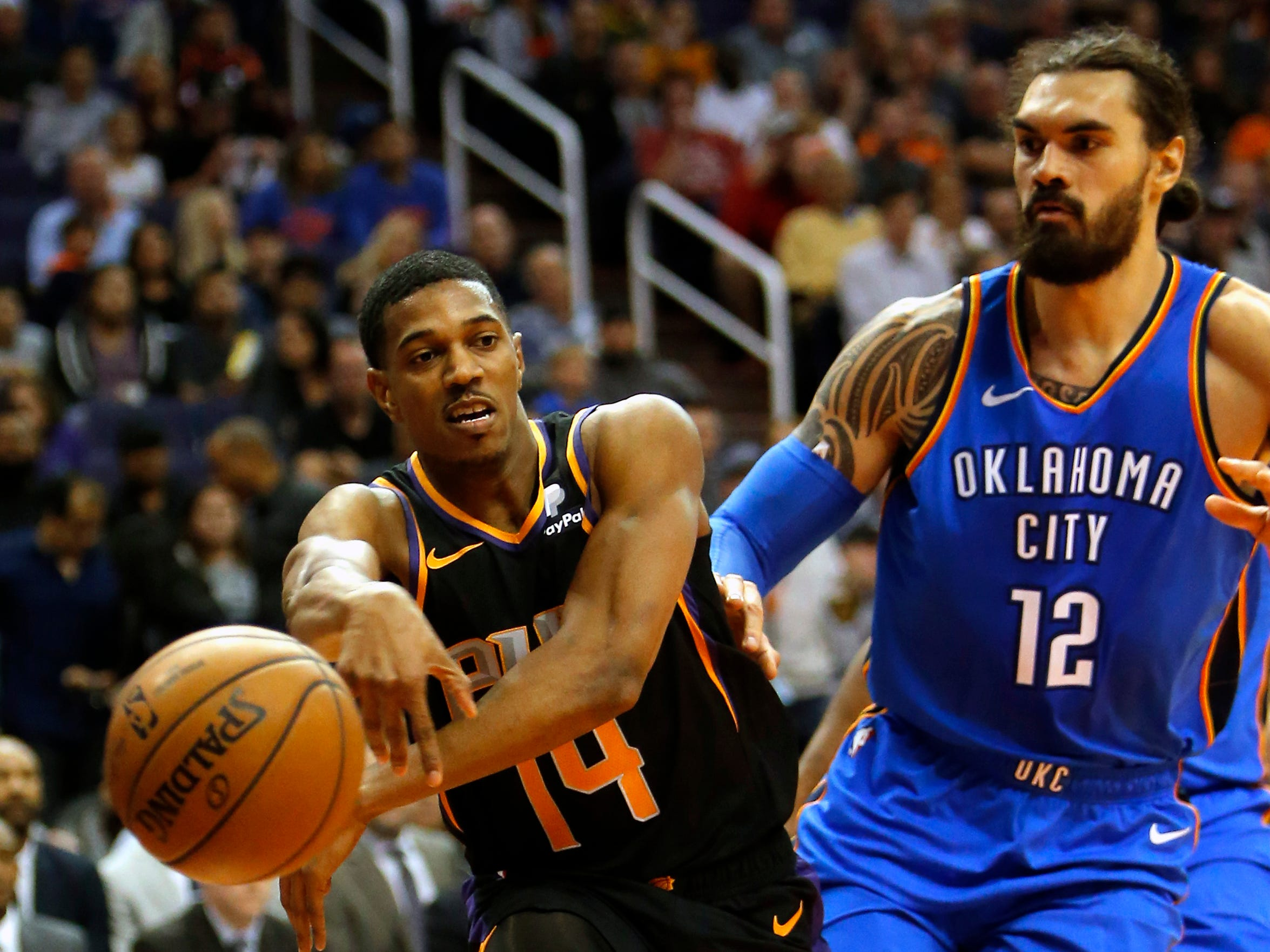 Phoenix Suns guard De'Anthony Melton (14) in the first half during an NBA basketball game against the Oklahoma City Thunder, Saturday, Nov. 17, 2018, in Phoenix. (AP Photo/Rick Scuteri)