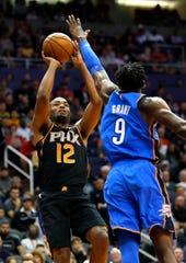 Phoenix Suns forward TJ Warren (12) in the first half during an NBA basketball game against the Oklahoma City Thunder, Saturday, Nov. 17, 2018, in Phoenix. (AP Photo/Rick Scuteri)