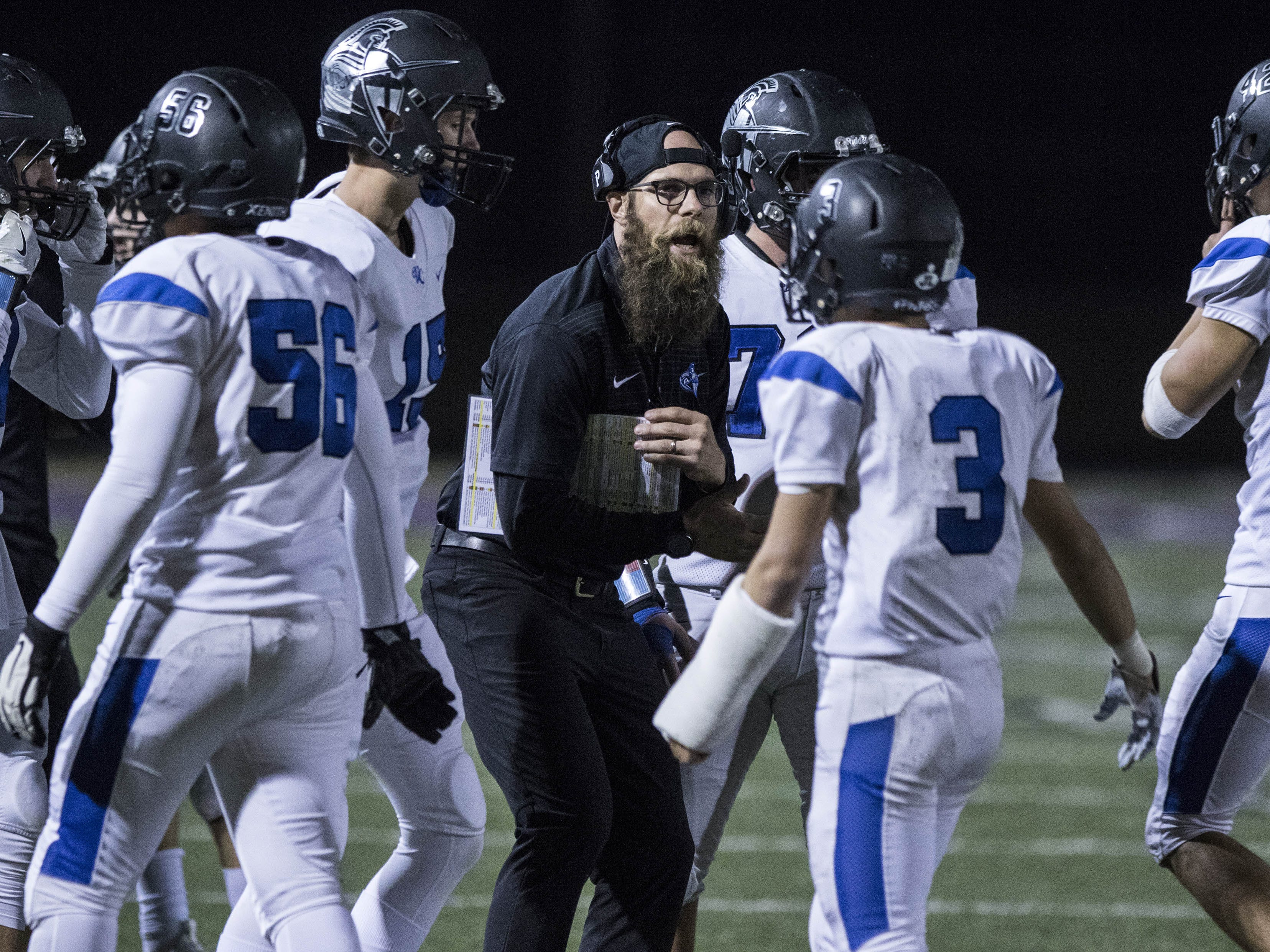 Valley Christian coach Kirk Sundberg talks to his players during their game with Northwest Christian at North Canyon High School in Phoenix  Friday, Nov.17, 2018. #azhsfb