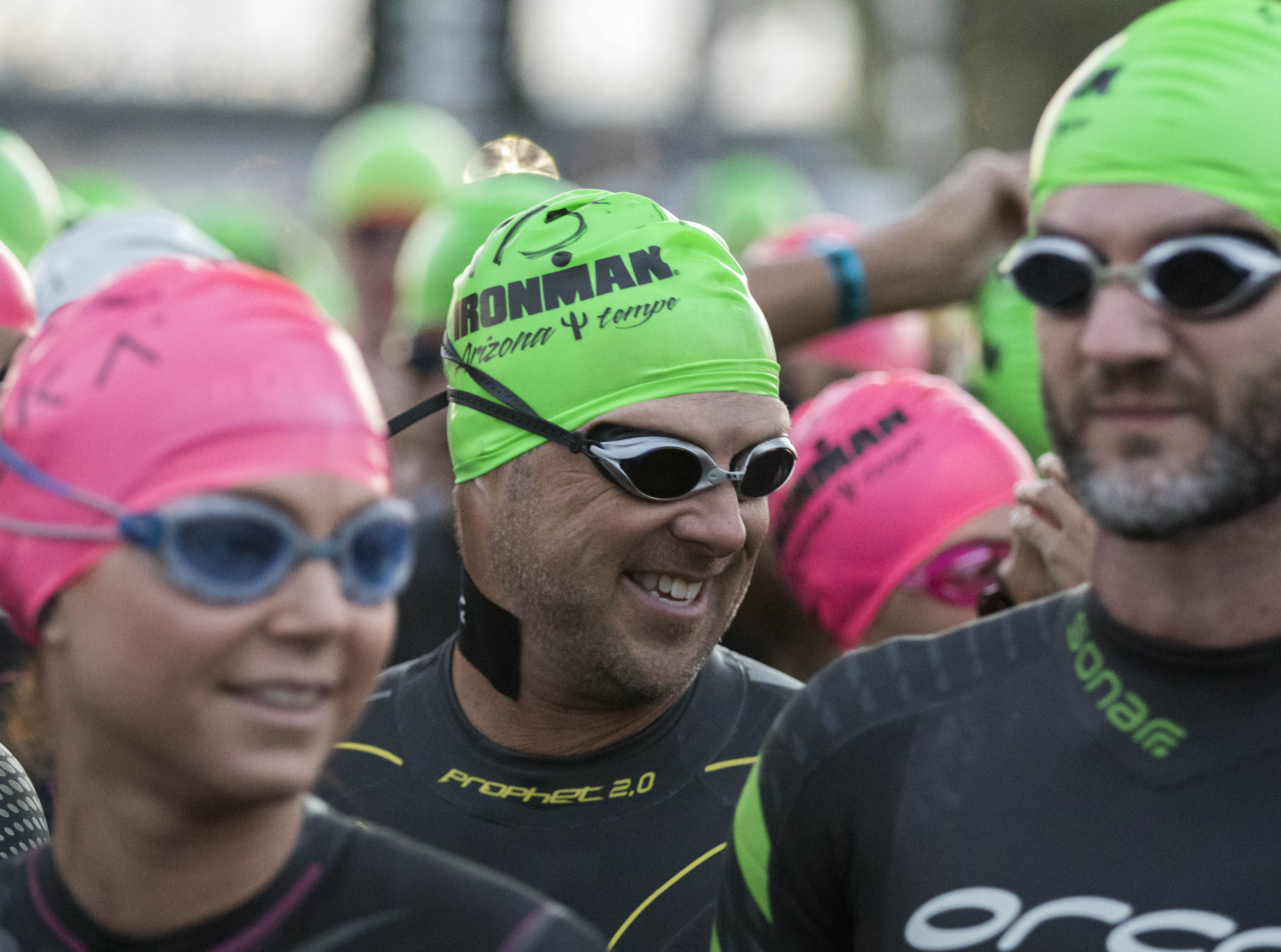 Competitors are all smiles as they start their swim during the Tempe Ironman at Tempe Town Lake Nov.18, 2018.