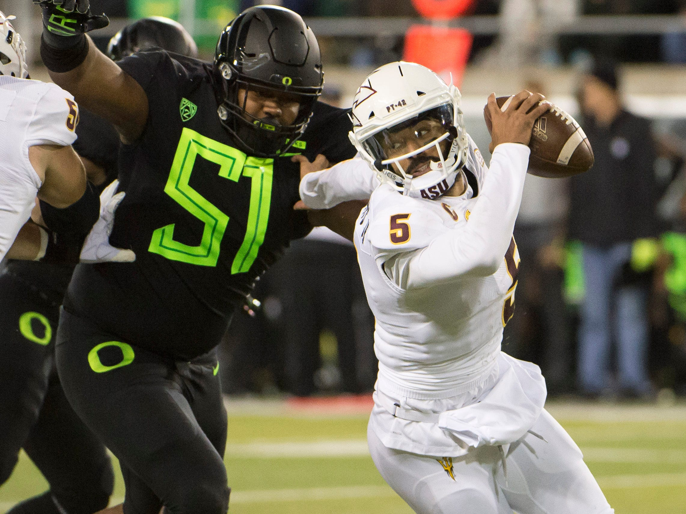 Nov 17, 2018; Eugene, OR, USA; Arizona State Sun Devils quarterback Manny Wilkins (5) is pressured by Oregon Ducks defensive lineman Gary Baker (51 during the first half at Autzen Stadium. Mandatory Credit: Troy Wayrynen-USA TODAY Sports