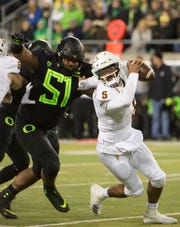 Arizona State Sun Devils quarterback Manny Wilkins (5) is pressured by Oregon Ducks defensive lineman Gary Baker (51 during the first half at Autzen Stadium.Troy Wayrynen-USA TODAY Sports