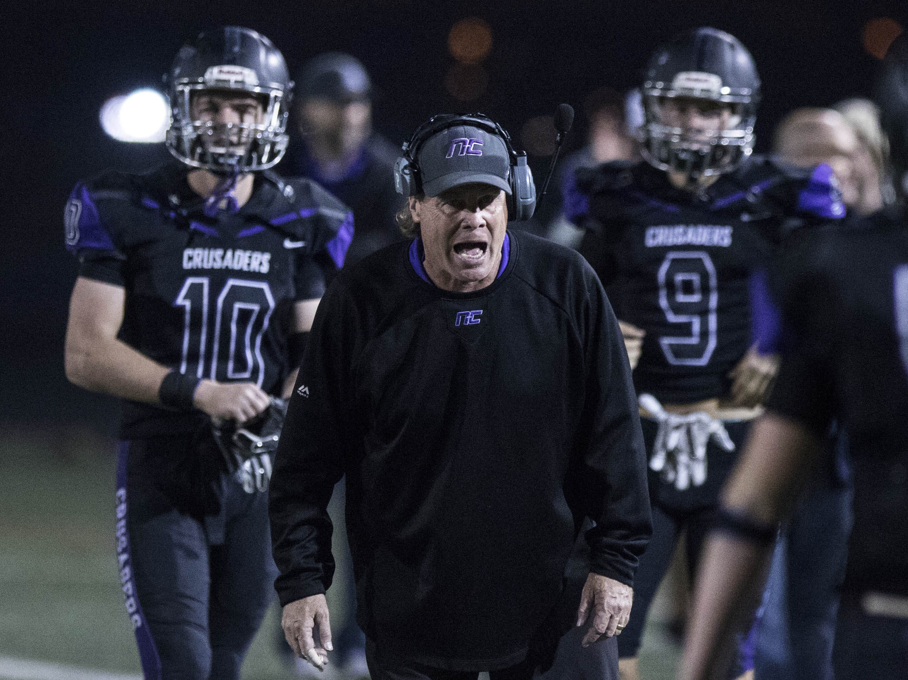 Northwest Christian coach David Inness calls out to his players against Valley Christian during their game at North Canyon High School in Phoenix  Friday, Nov.17, 2018. #azhsfb