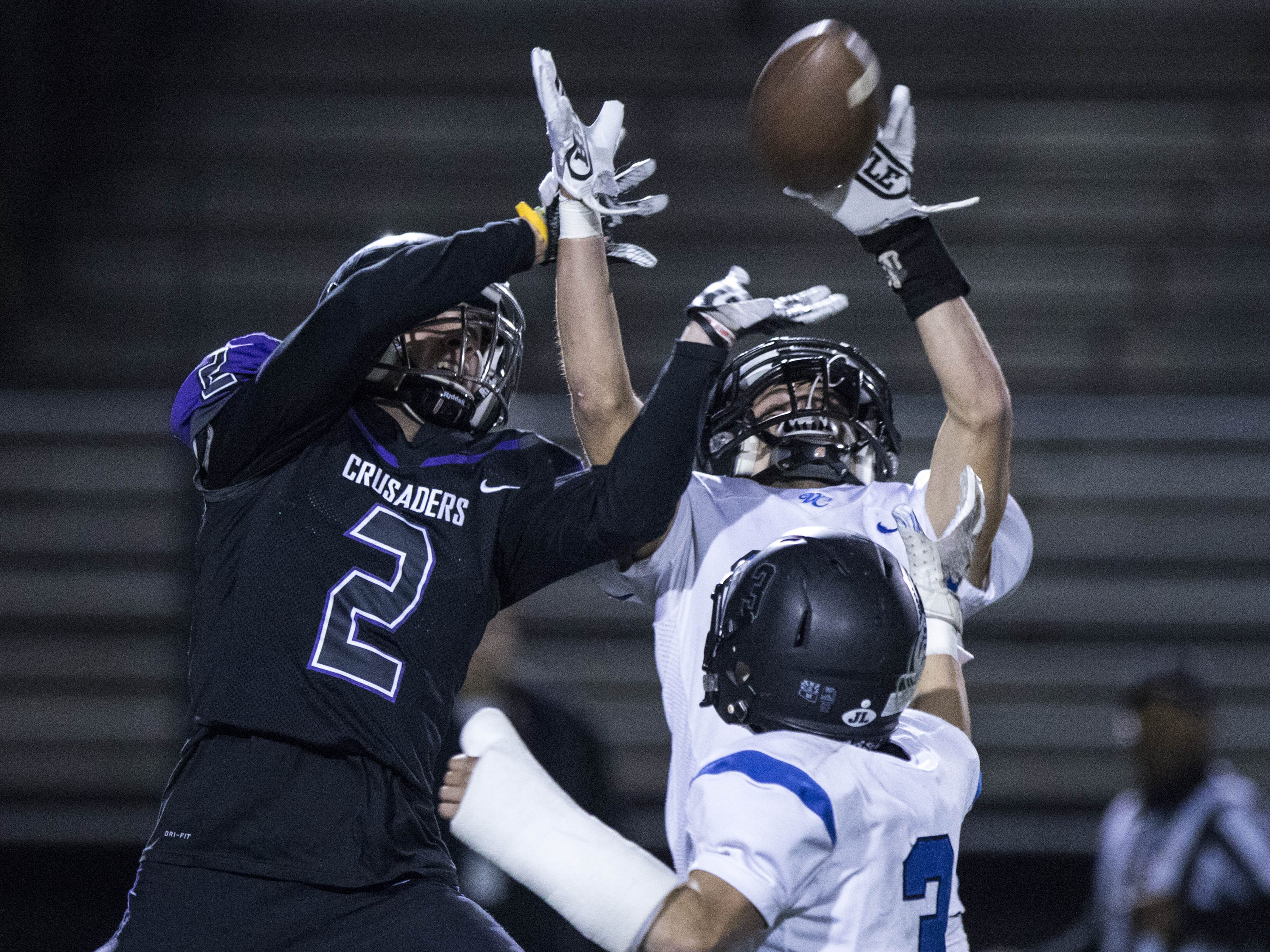 Northwest Christian's Adam Bunch (2) and Valley Christian's Tanner Canfield (21) battle for the ball during their game  at North Canyon High School in Phoenix  Friday, Nov.17, 2018. #azhsfb