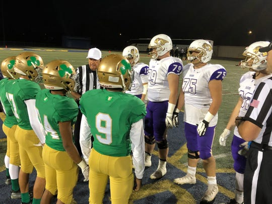 Yuma Catholic and Sabino captains stand at midfield before its semi-final matchup on Saturday, Nov. 17, 2018.