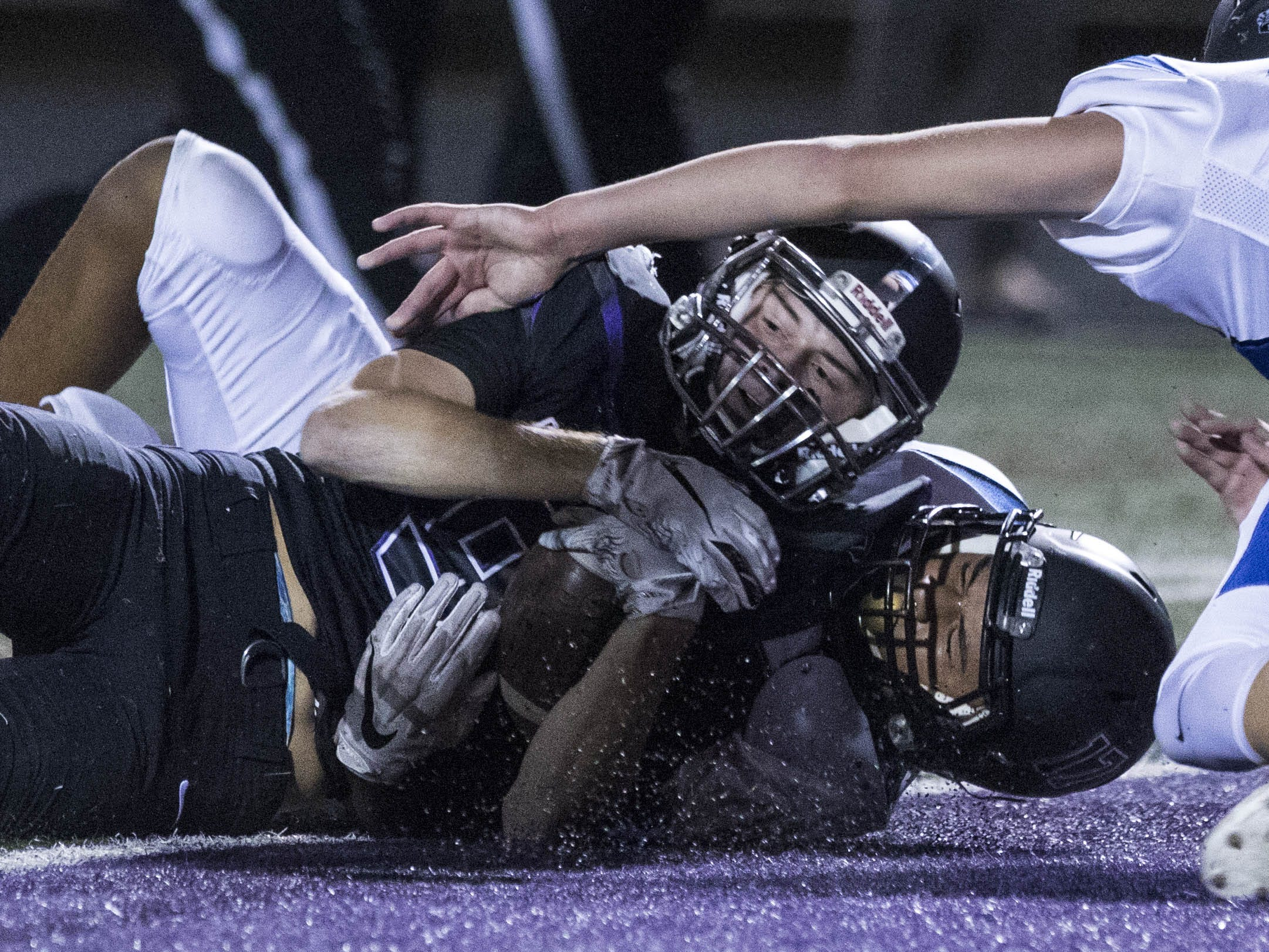 Northwest Christian's Brady Wijbrandts (9) falls into the endzone for the Crusaders' first touchdown during their game with Valley Christian at North Canyon High School in Phoenix  Friday, Nov.17, 2018. #azhsfb