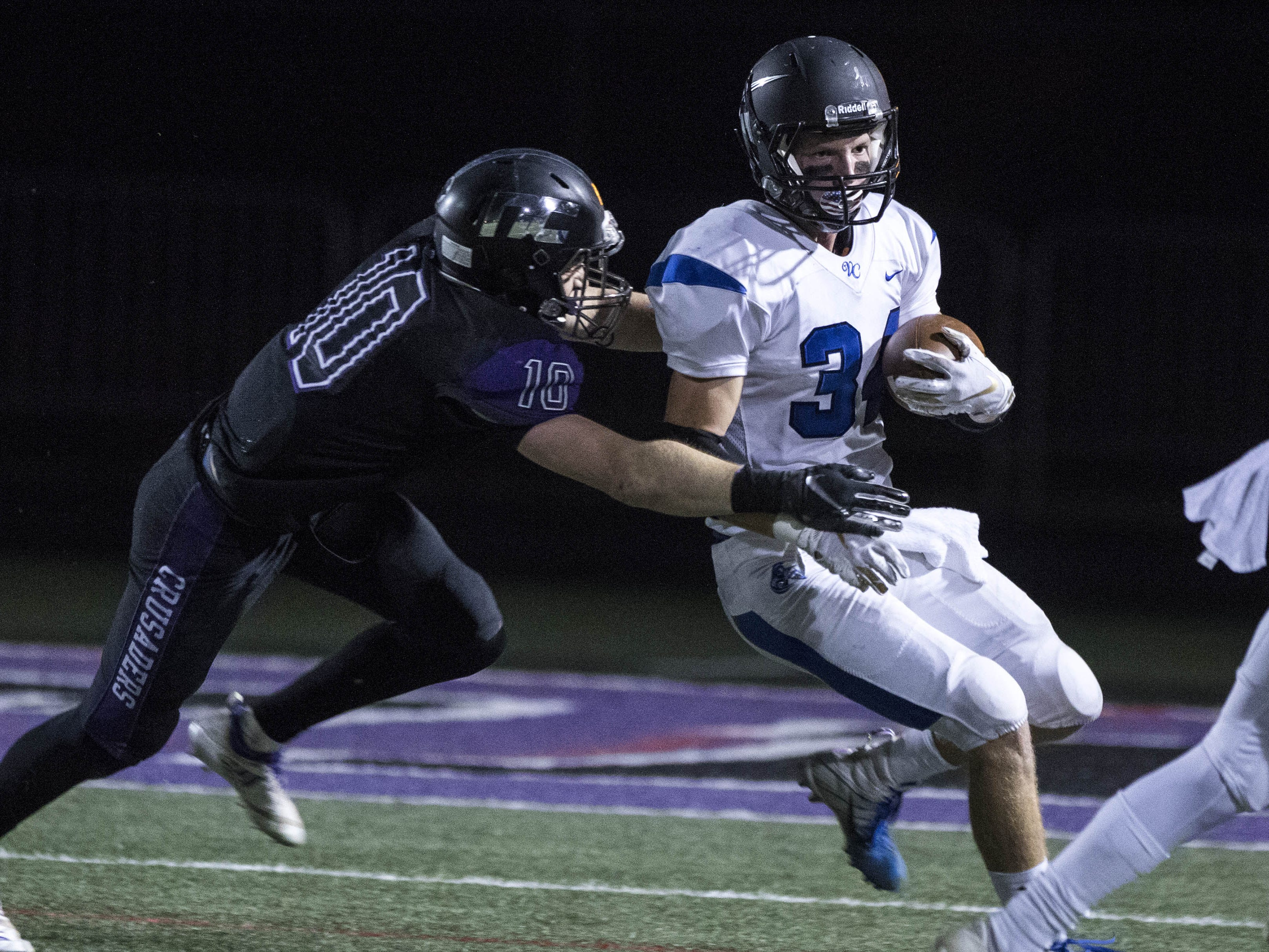 Northwest Christian's Aren Van Hofwegen (10) tackles   Valley Christian's Nathan Dykstra (34) during their game at North Canyon High School in Phoenix  Friday, Nov.17, 2018. #azhsfb