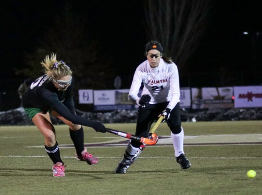 Palmyra's Lauren Wadas, right, battles for possession of the ball.