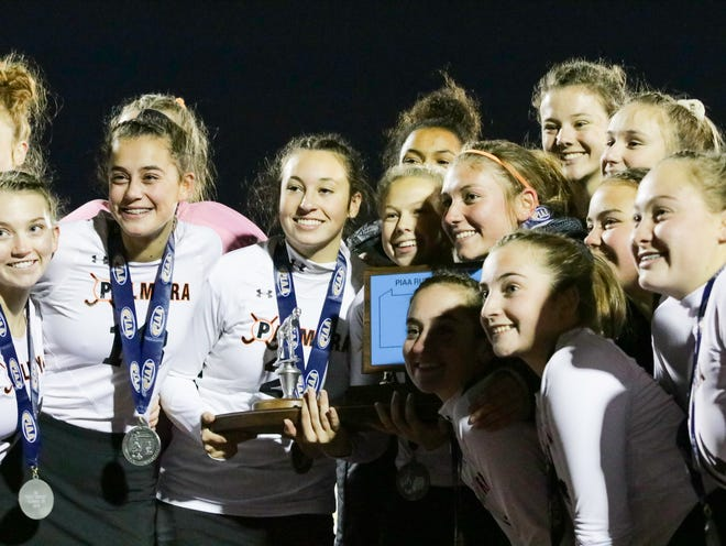 The Palmyra field hockey team smiles as it accepts its state runner-up trophy on Saturday night after a 1-0  OT loss to Donegal in the 2A state championship game.